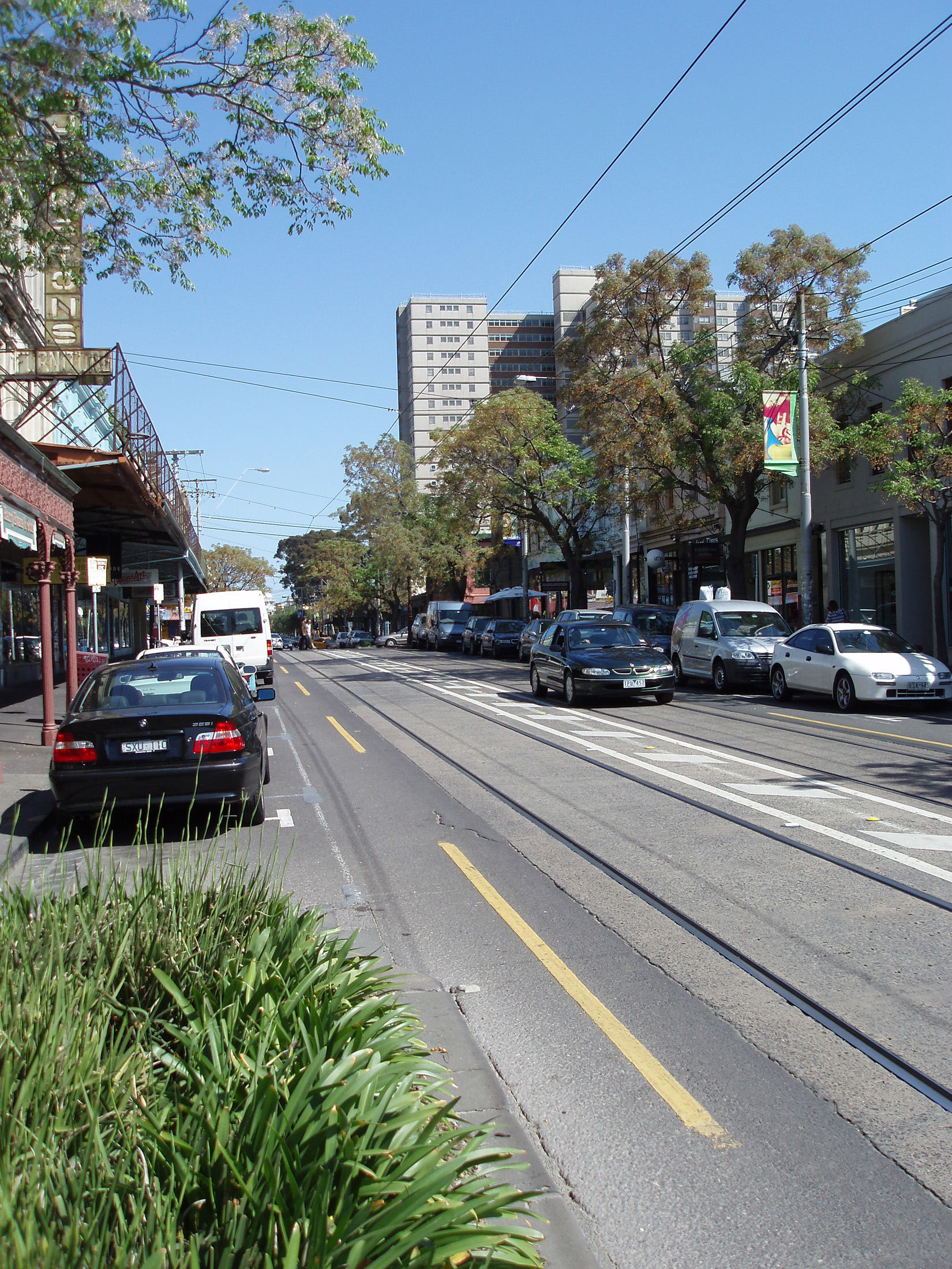 Cars at Famous Fitzroy Street in Melbourne with no Traffic During Morning Time.