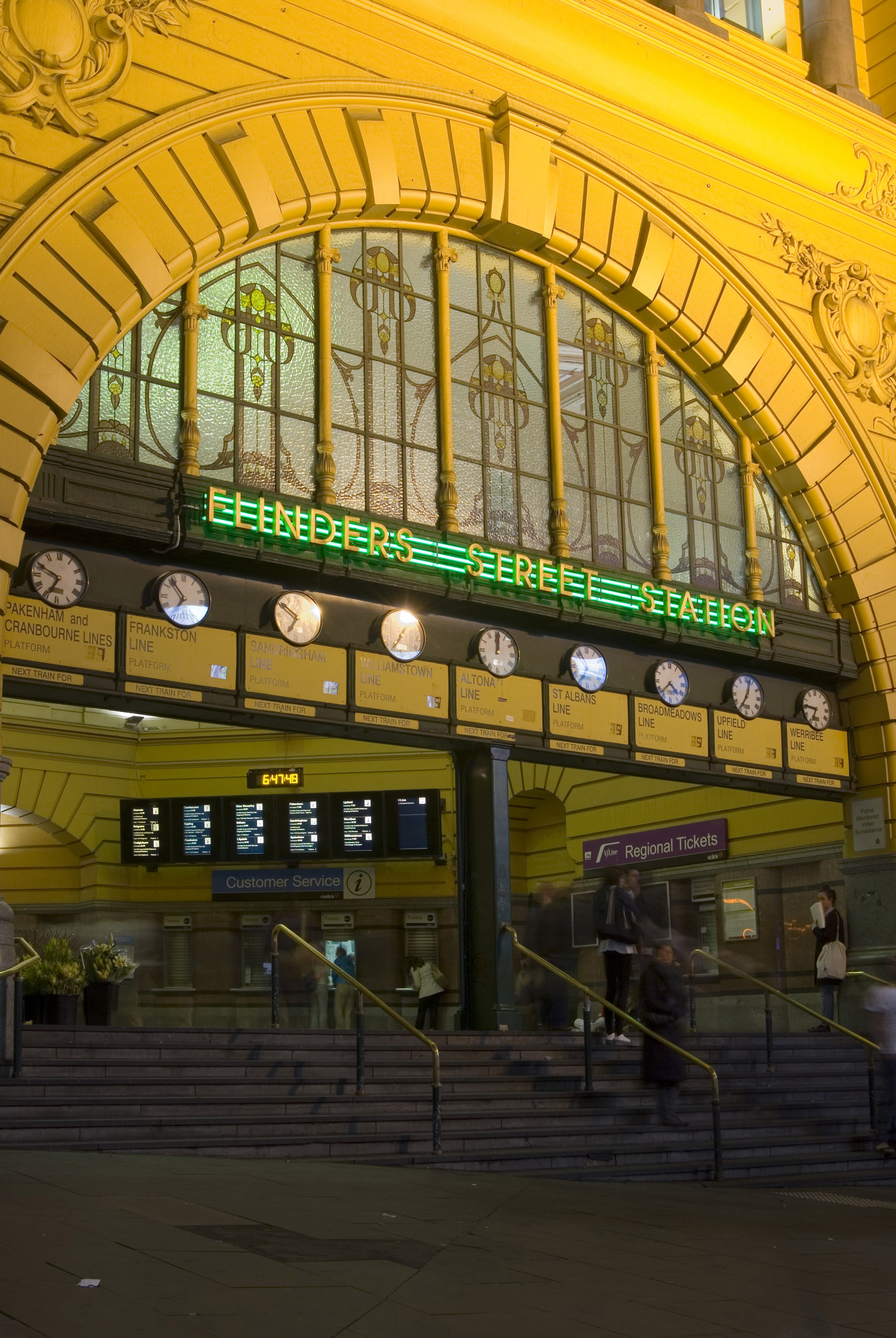 The entrance to Flinders street railway station in Melbourne, Australia at night time.