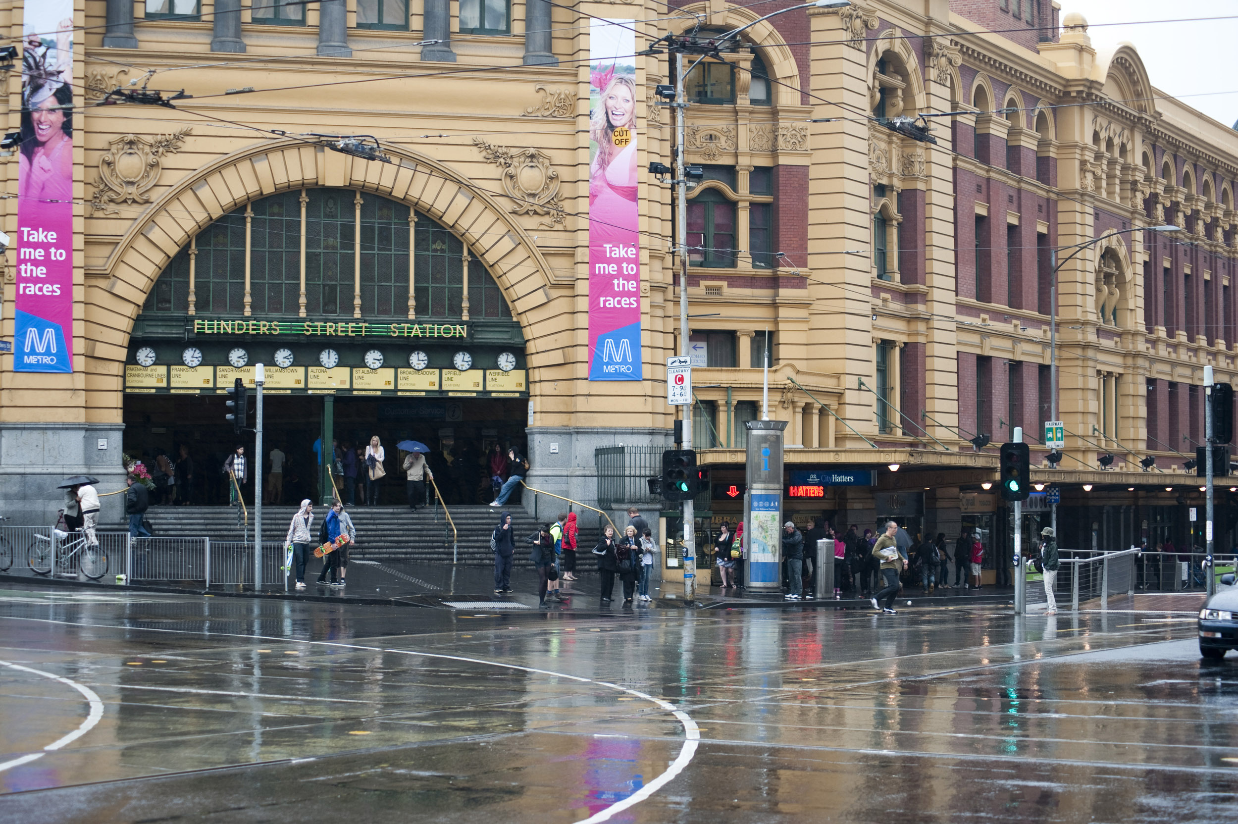 Flinders Street, Melbourne, Australia in the rain with the arched entrance to the station across the street