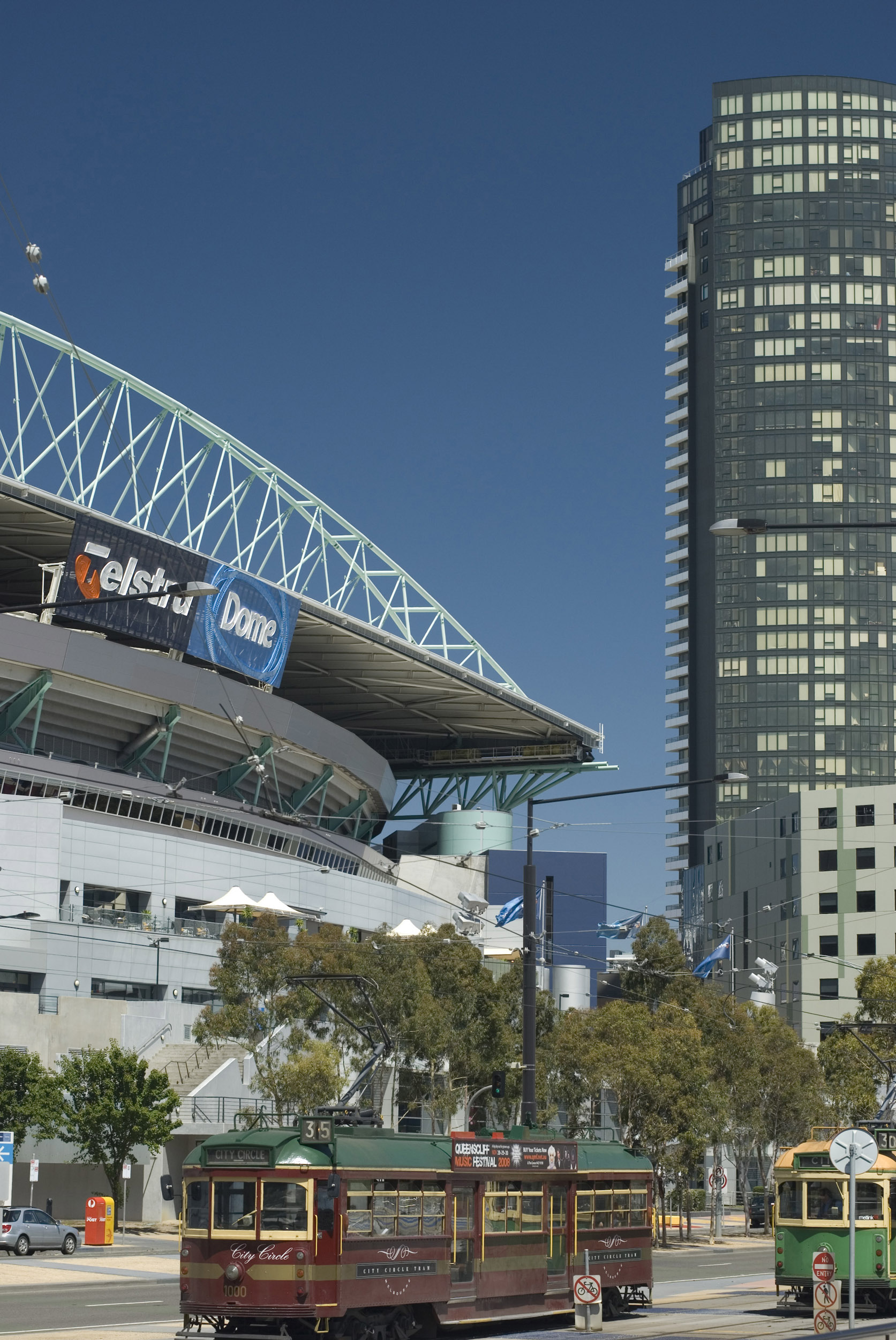The exterior and city surrounding the Telstra Dome stadium in Melbourne, Australia.