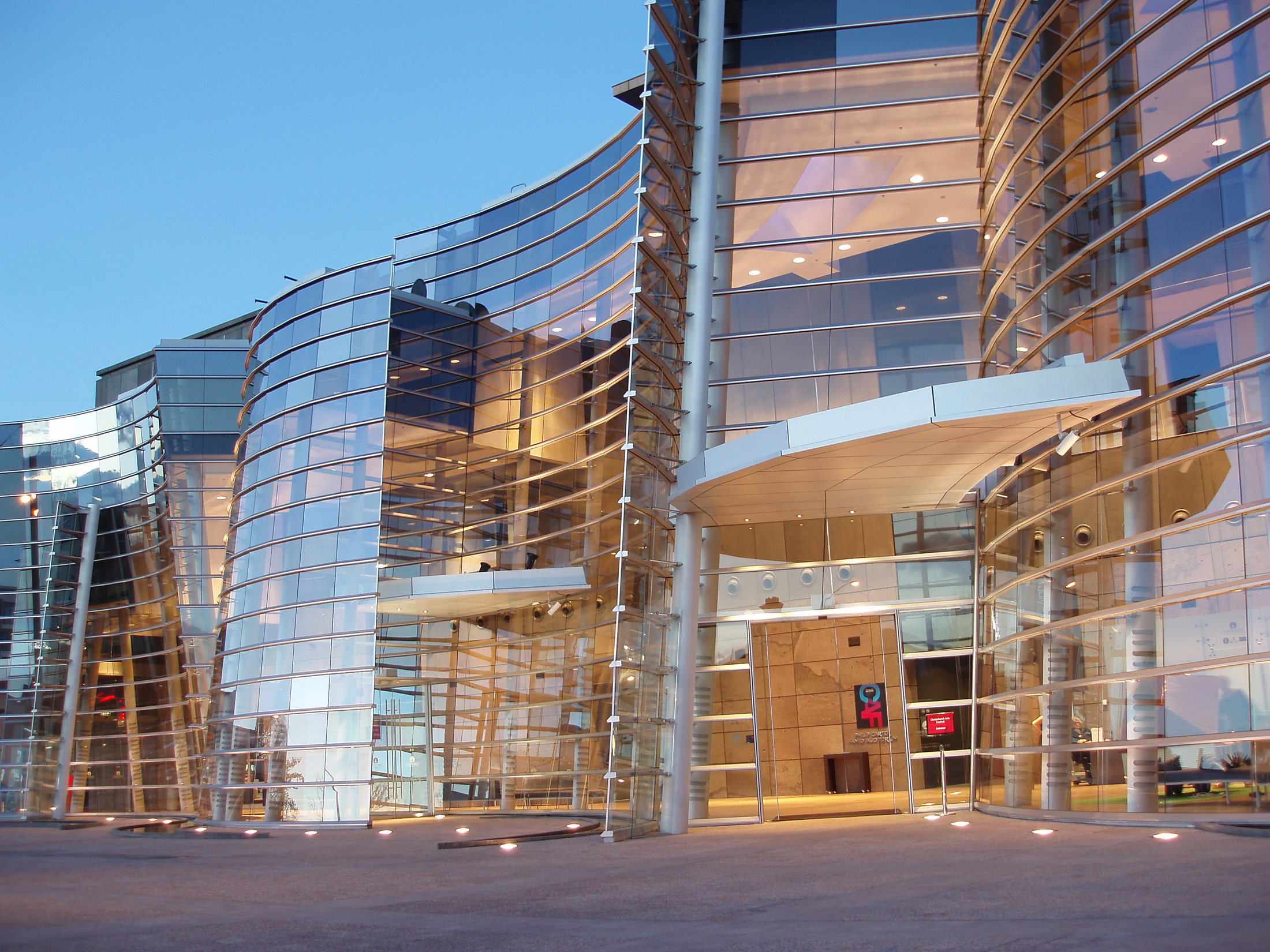 reflective glass font of the christchurch art gallery at sunset,