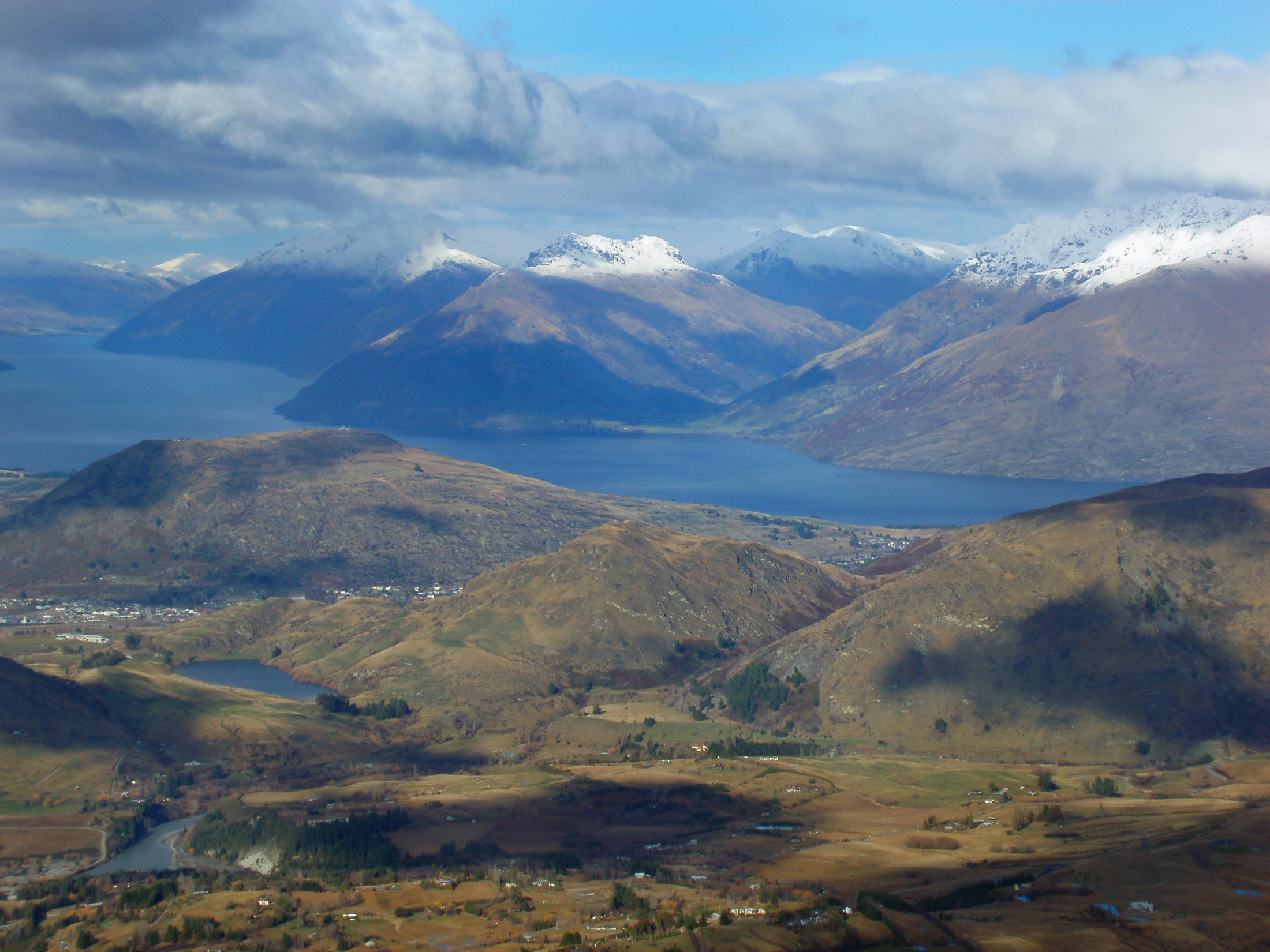 snow covered mountains around Lake Wakatipu viewed from coronet peak