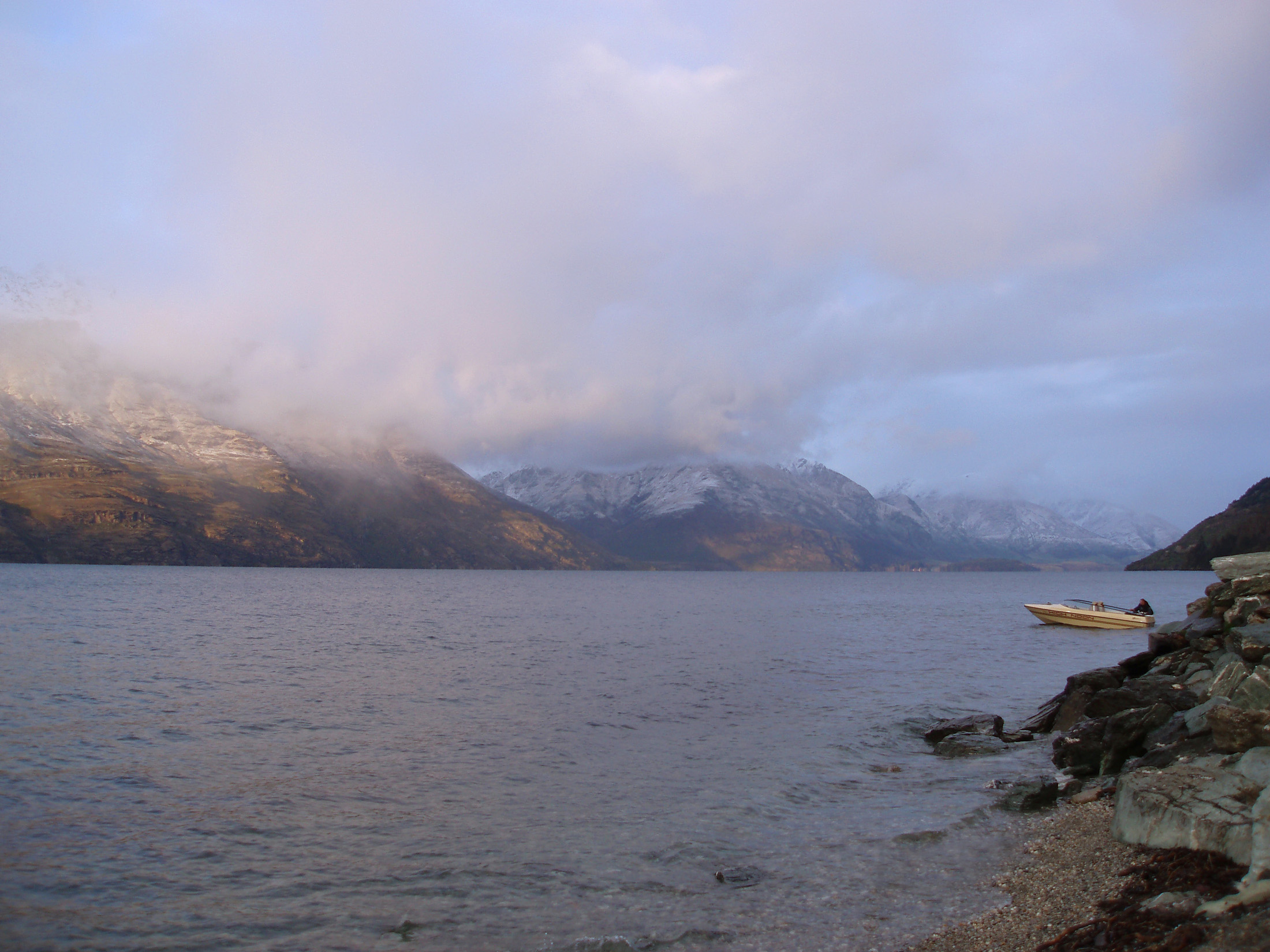 a strom day over lake lake wakatipu, queenstown, new zealand,