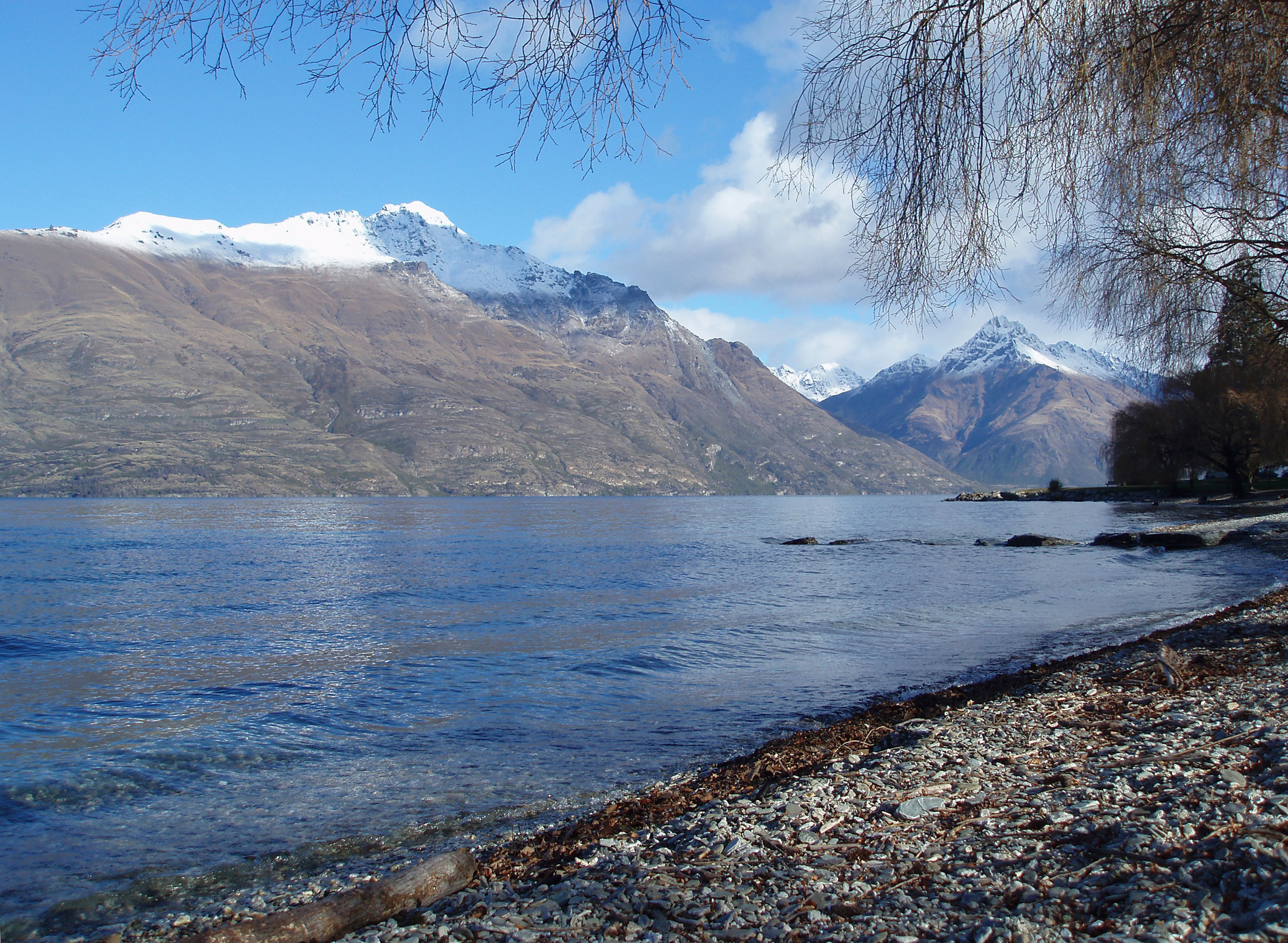 serene waters lake seen from the shores of lake wakatipu in queenstown