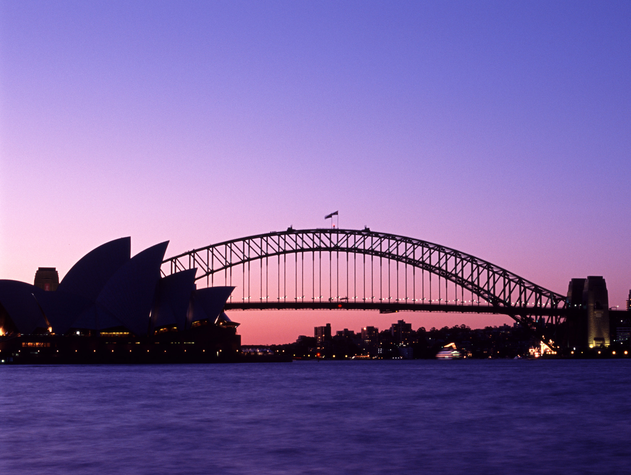 Silhouette of Sydney Harbor Bridge and Opera House with Purple Sunset