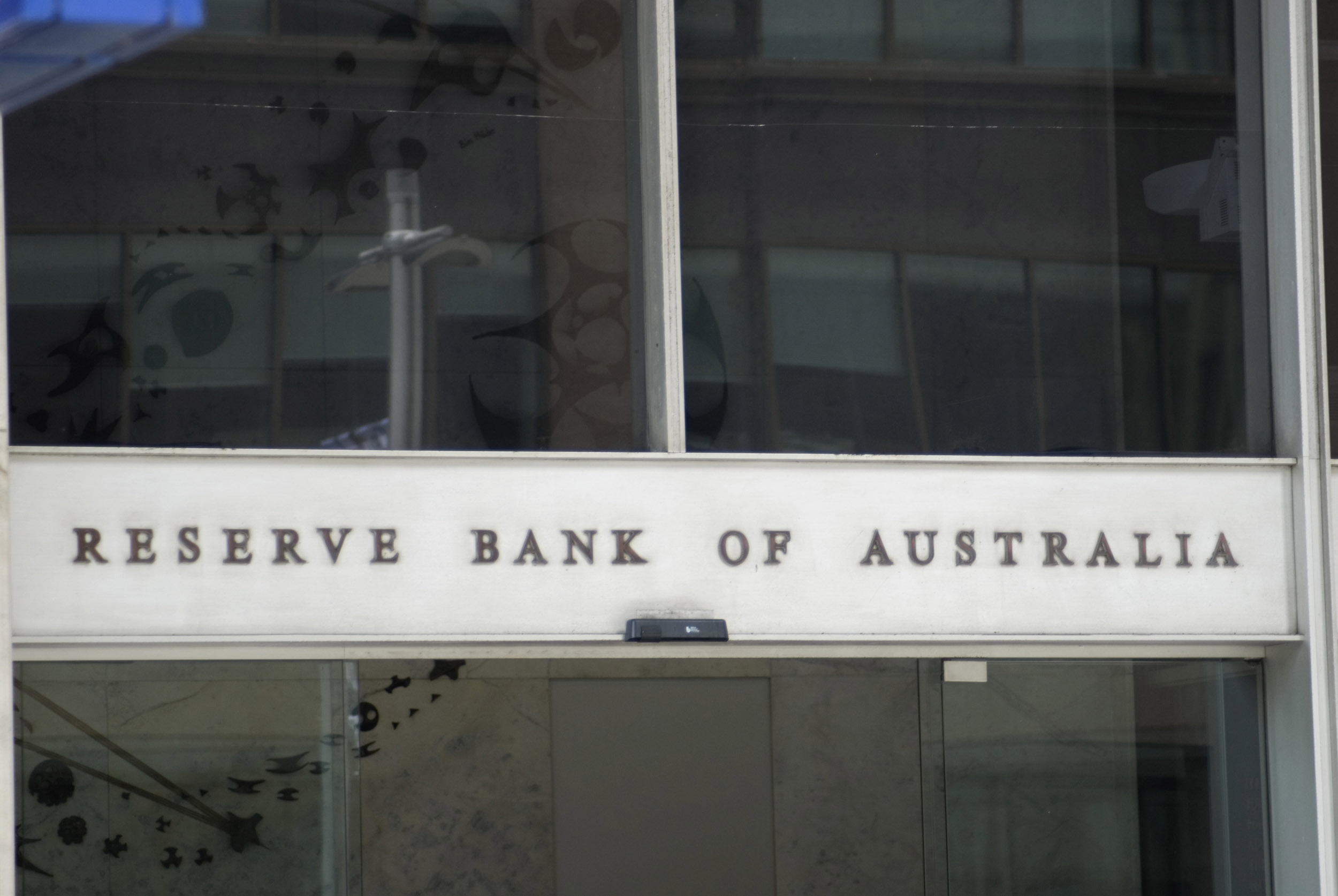 A close up of the sign above the building entrance to the Reserve Bank of Australia.
