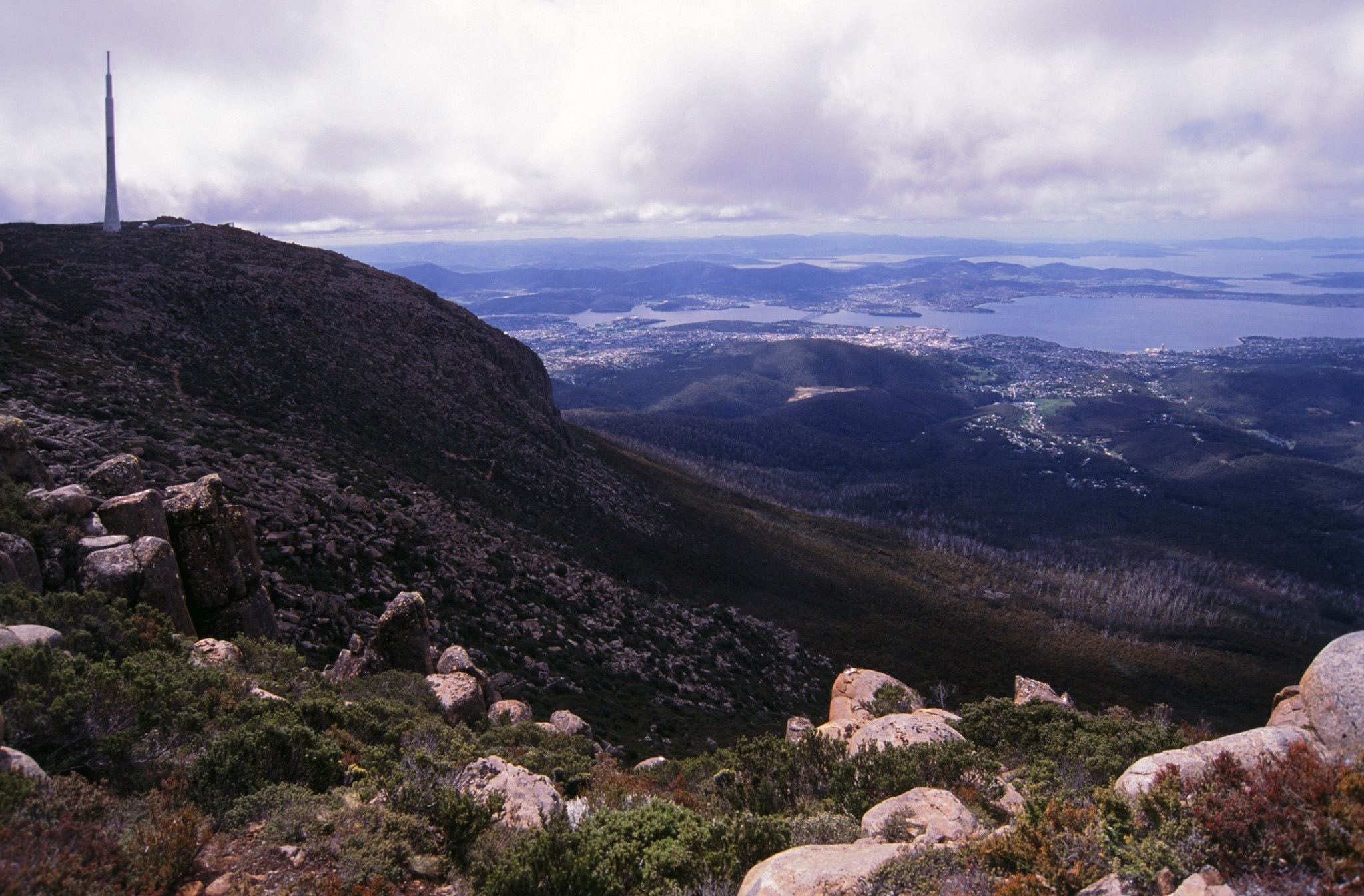 View from Mount Wellington, Tasmania over the surrounding countryside and Derwent Estuary with the city of Hobart