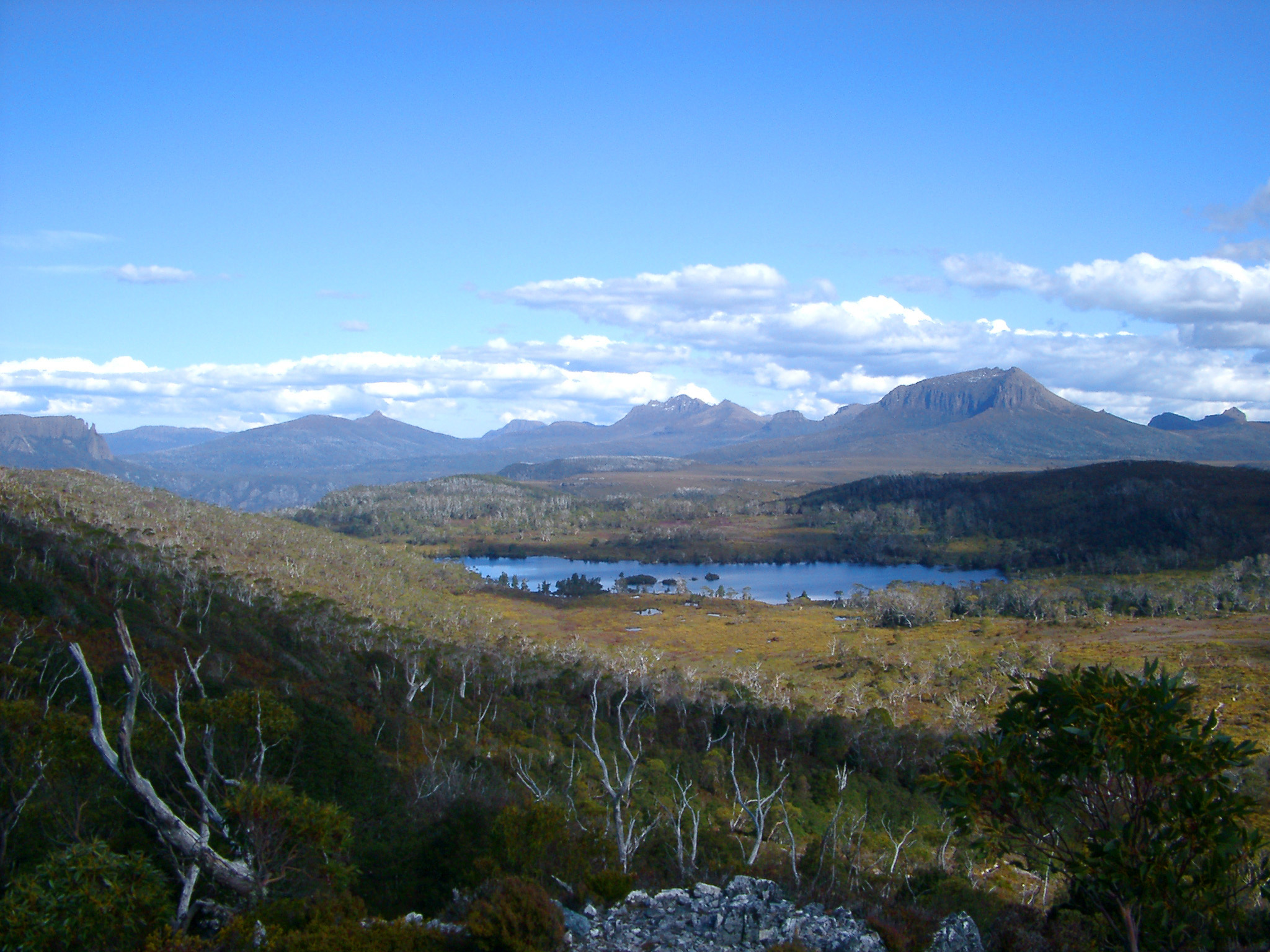 Scenic view of Lake Windermere, Tasmania from an overland track with distant mountain ranges
