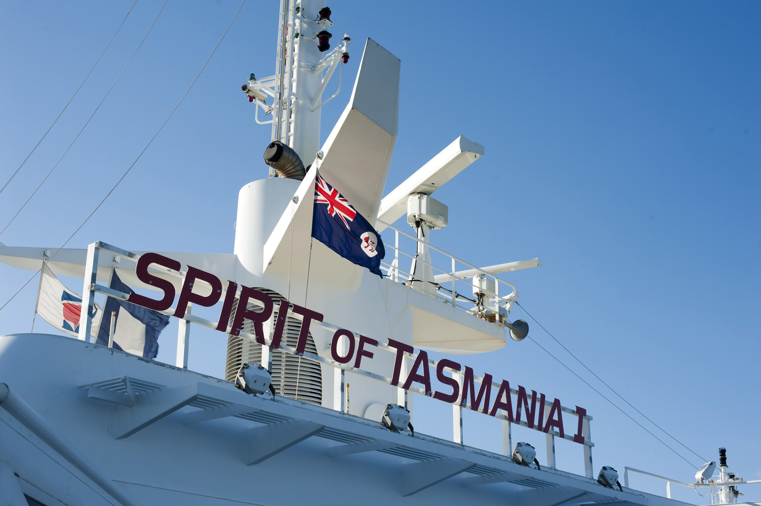 A close up of the Australian flag, radar and sonar equipment on the Spirit of Tasmania ferry in Australia.