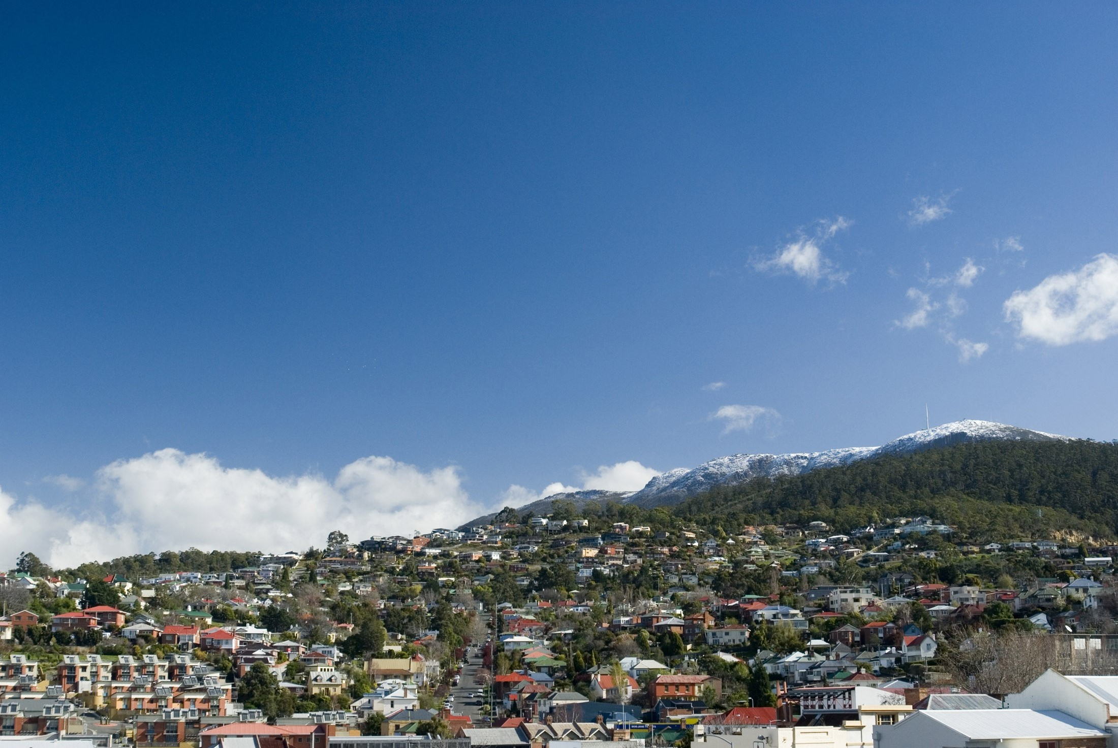 a clear winter day with snow on top of mount wellington, hobrart, tasmania