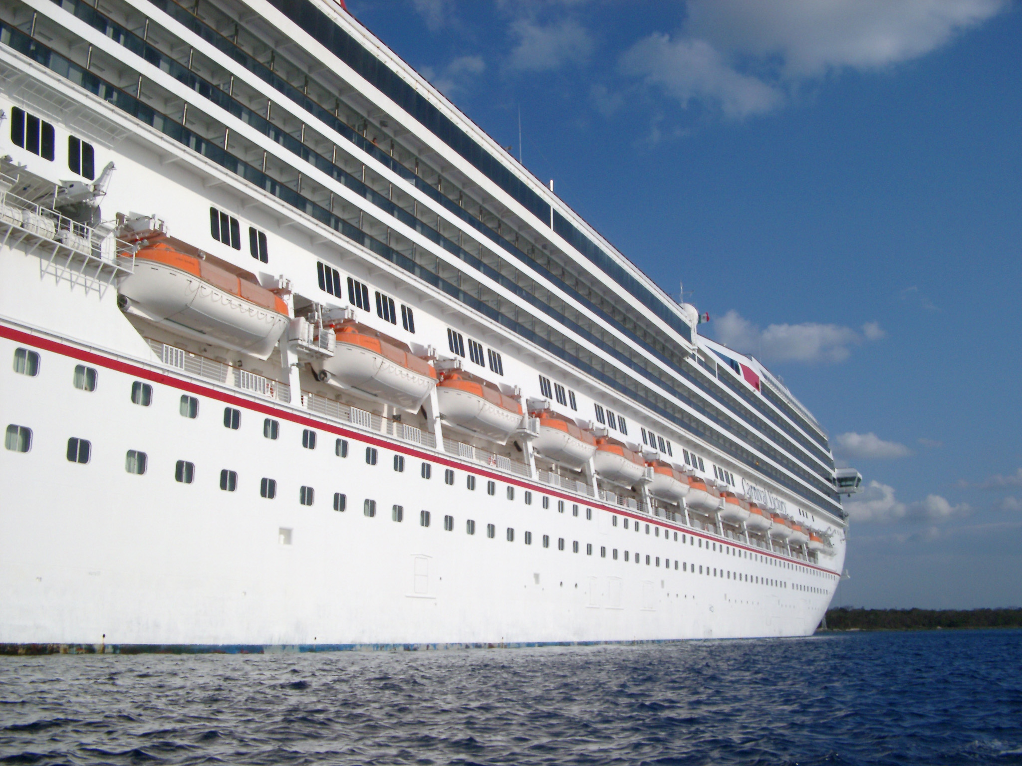 Side View Of A Cruise Ship Looking Down The Length Hull With Decks