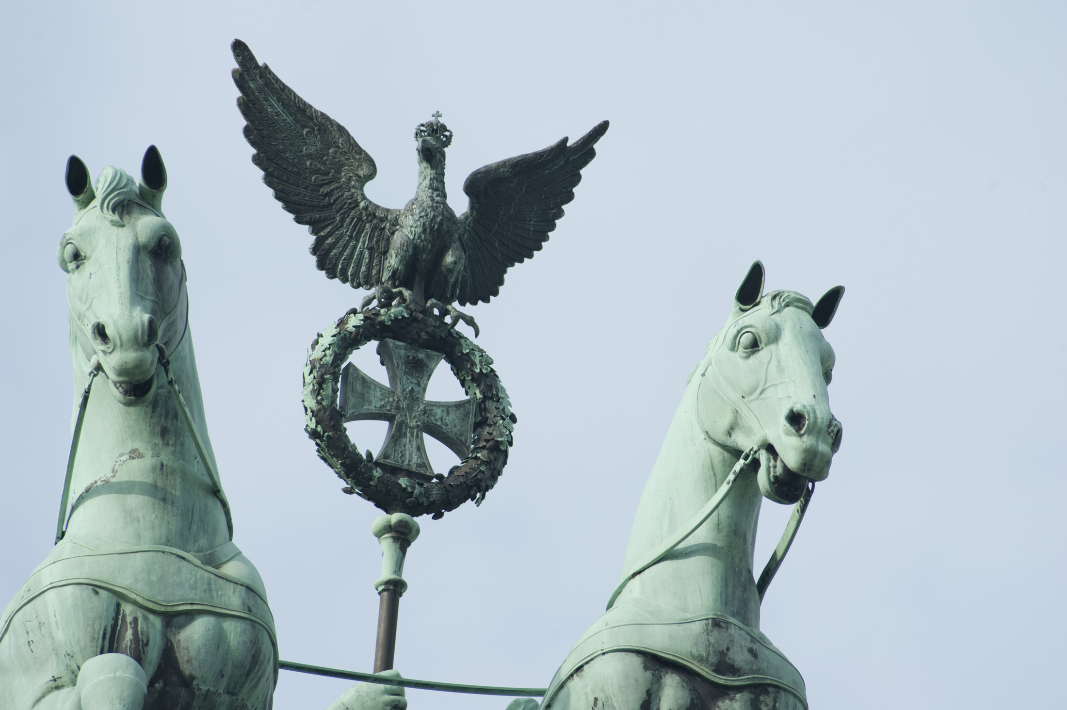 close up on the staff held by Victoria, roman goddess of vistory, on top of the brandenburg gate, berlin, germany
