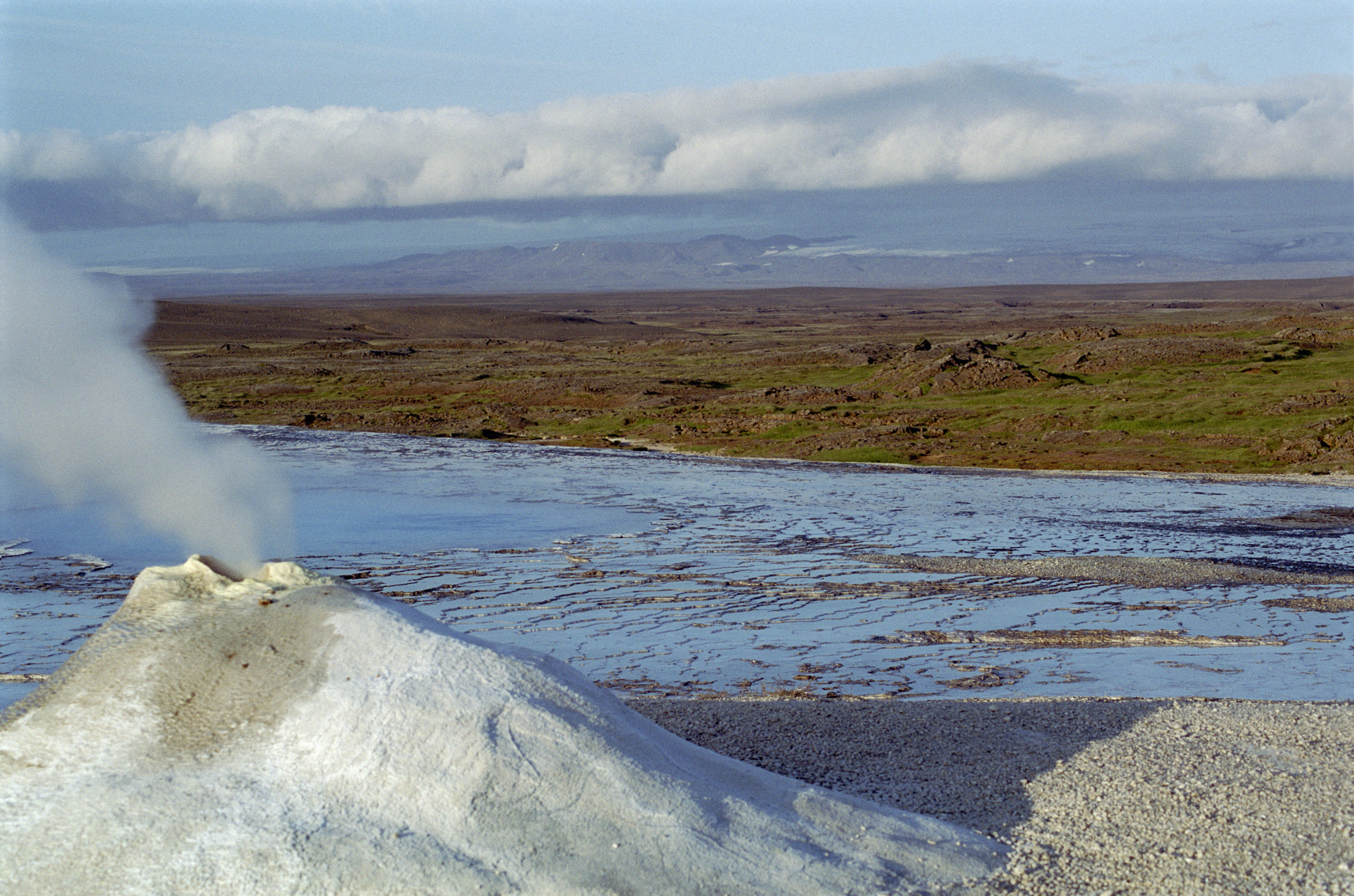 Fumerole emitting steam in Iceland in Hveravellir releasing volcanic pressure from below the earths surface
