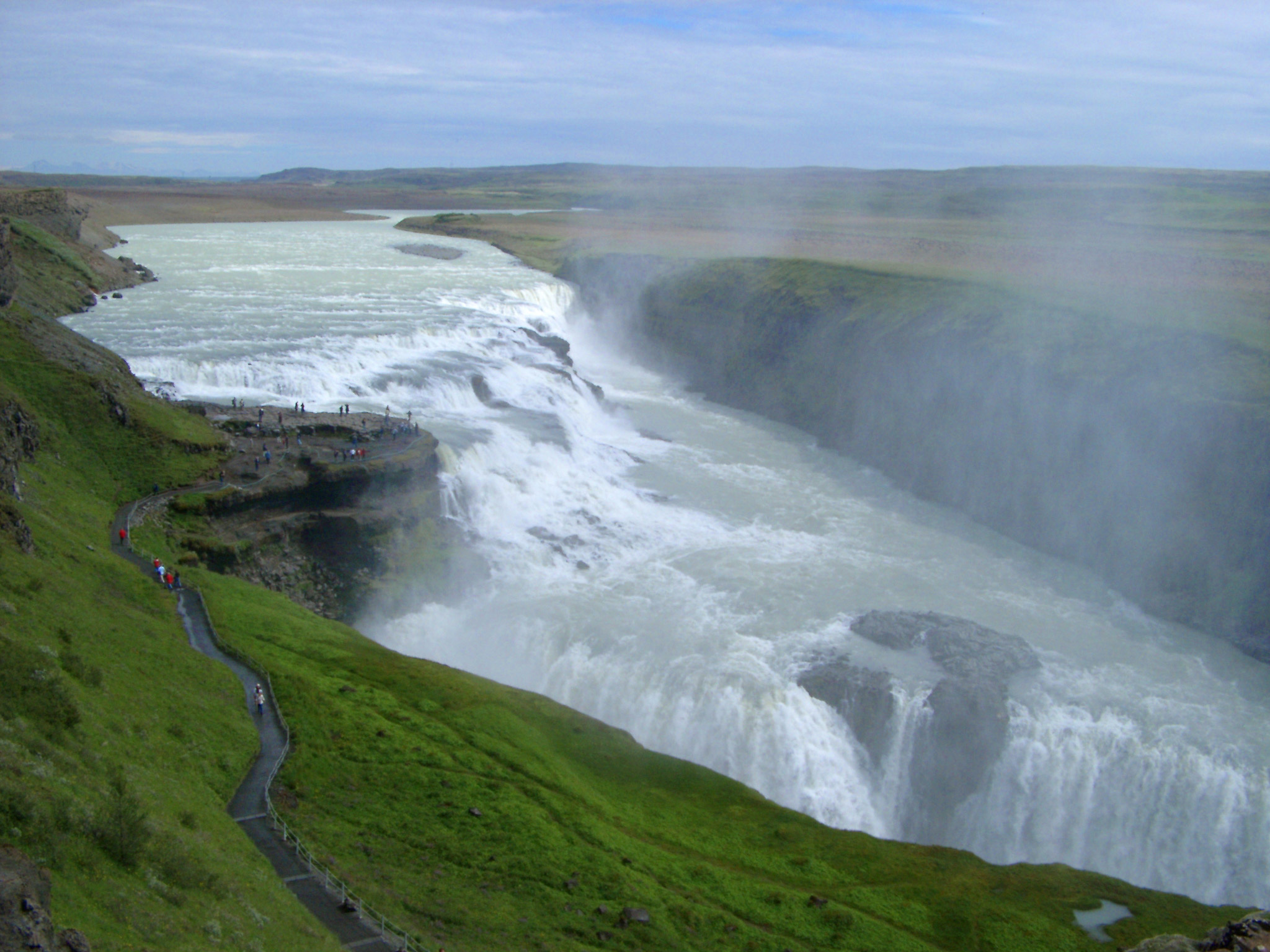 Scenic landscape view of the powerful flow of water and mist at Gullfoss waterfall, Iceland, in the Hvita River, which is a popular tourist attraction