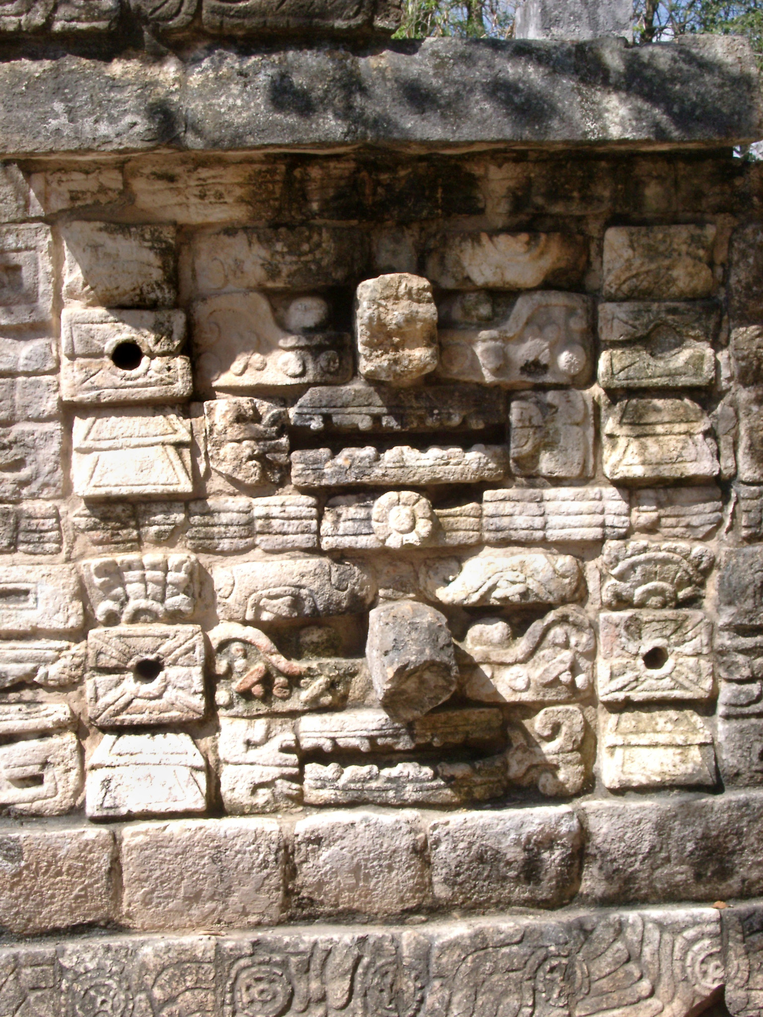 Old carved stone wall with tribal patterns in Chitzen Itza Mayan ruins in the Yucatan Province, Mexico