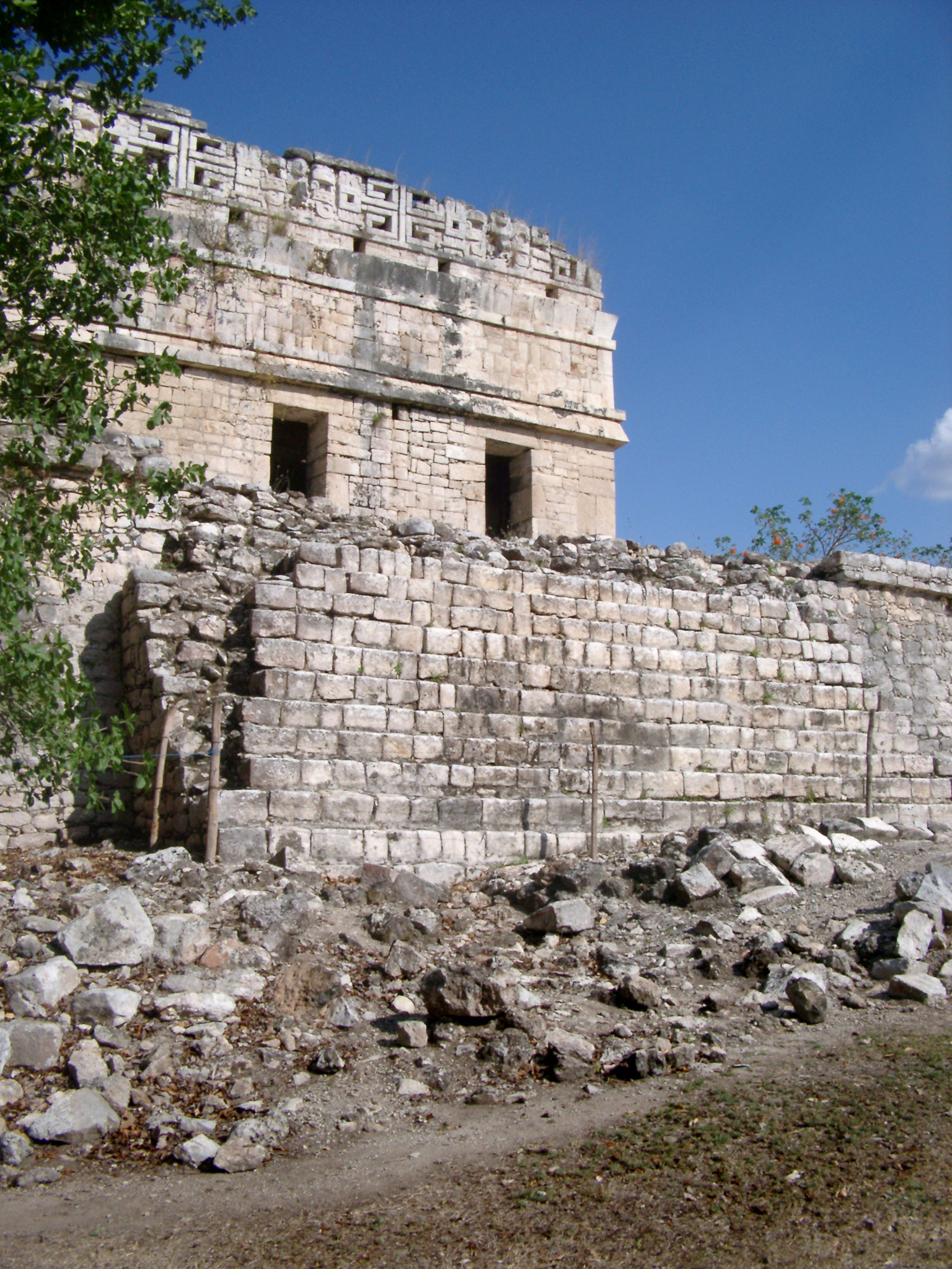 Ancient Disfigured Building Structure at Chichen Itza. Isolated on Blue Sky Background.