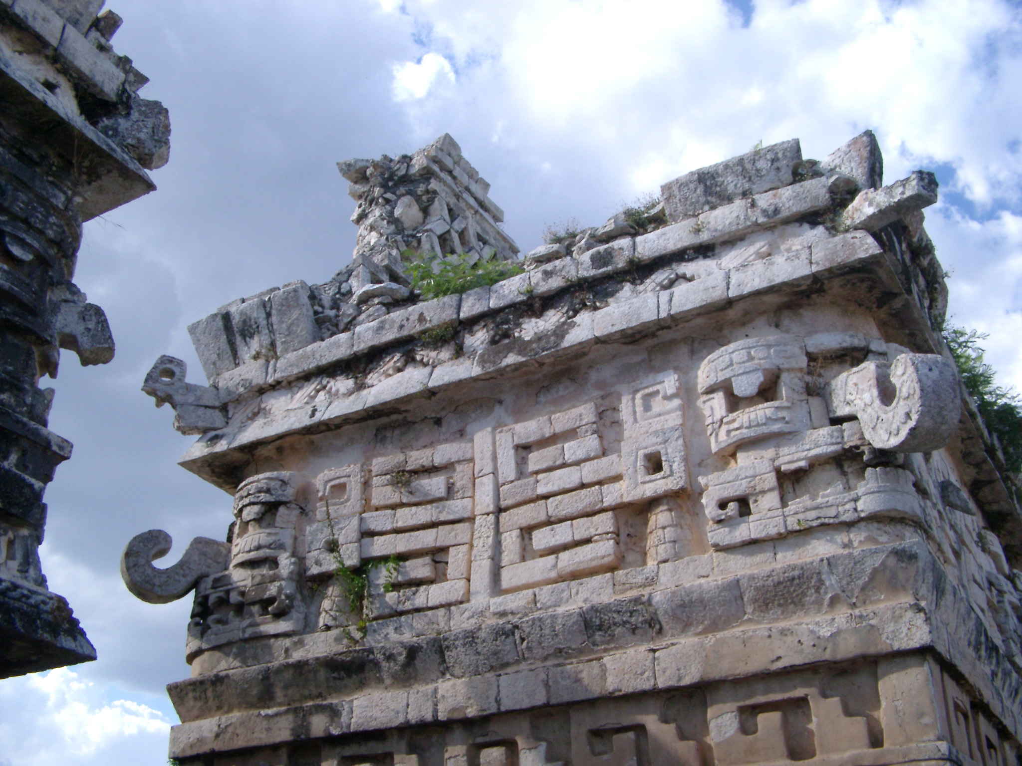 Ornate stone carvings with tribal patterns and hooked corner stones at Chitzen Itza Mayan ruins, an important archaeological site in the Yucatan Peninsula, Mexico