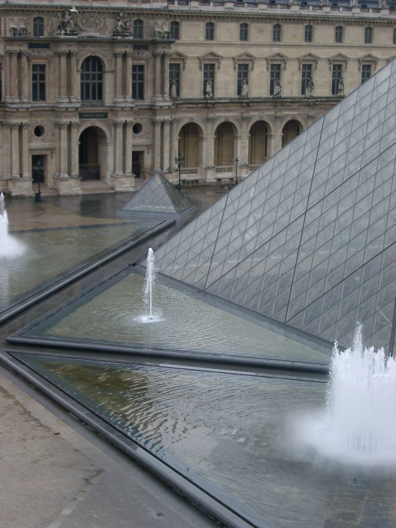 Pyramide Inversee and Water Fountains at Louvre Museum, Paris, France