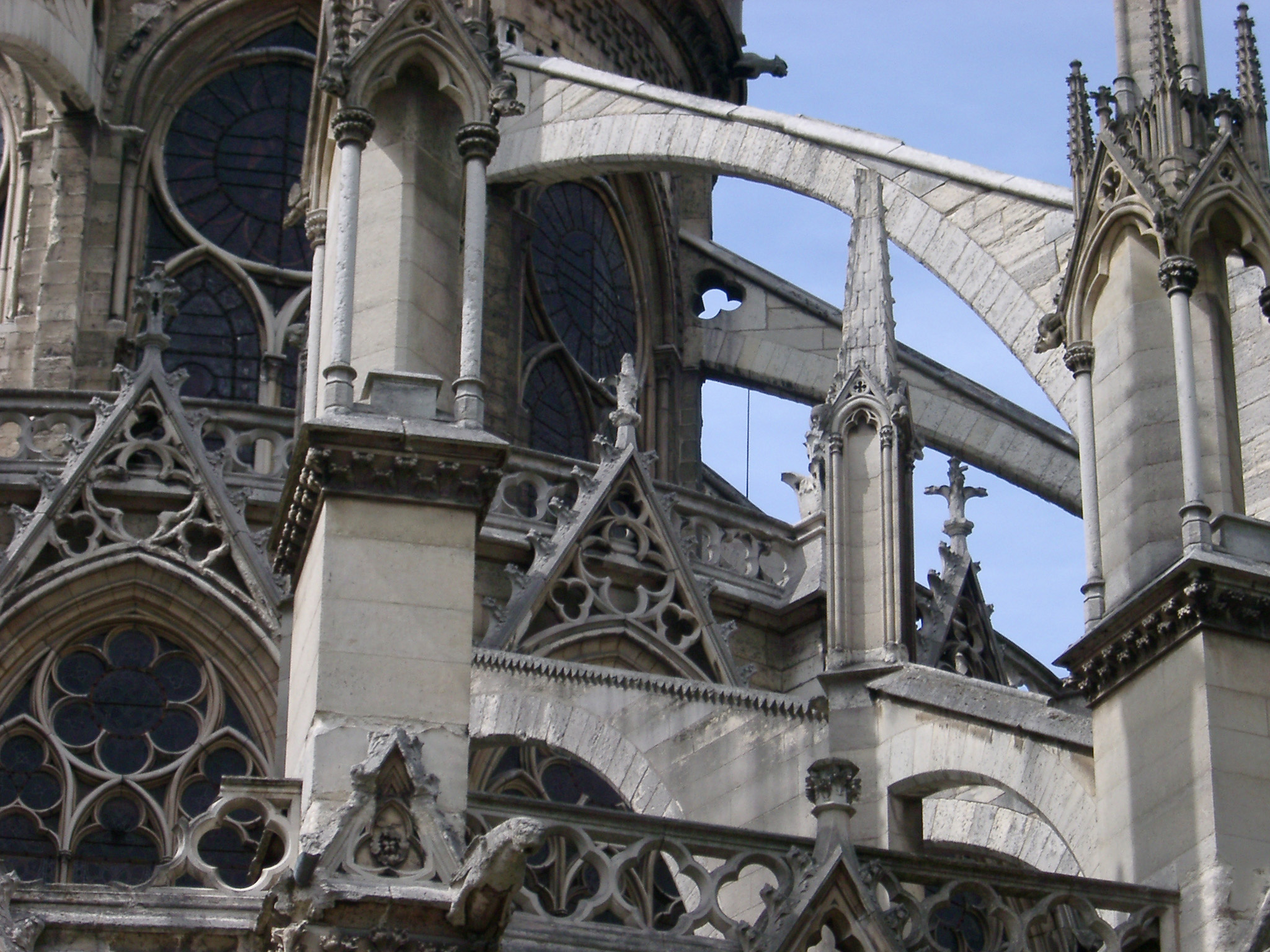 Notre Dame Cathedral architectural detail showing the flying buttress, gargoyles and stone spires, Paris