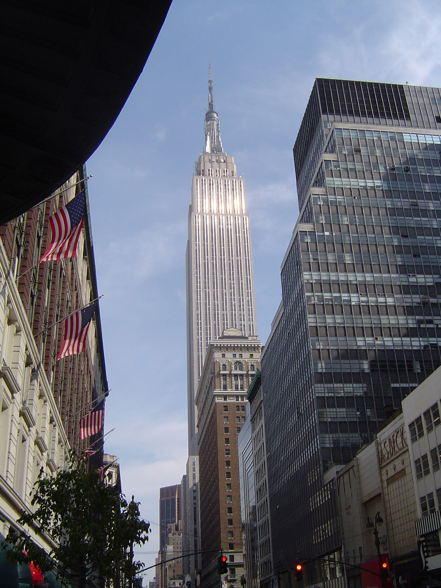 Famous High Architectural Empire State Building in New York, Isolated on Light Blue Sky Background.