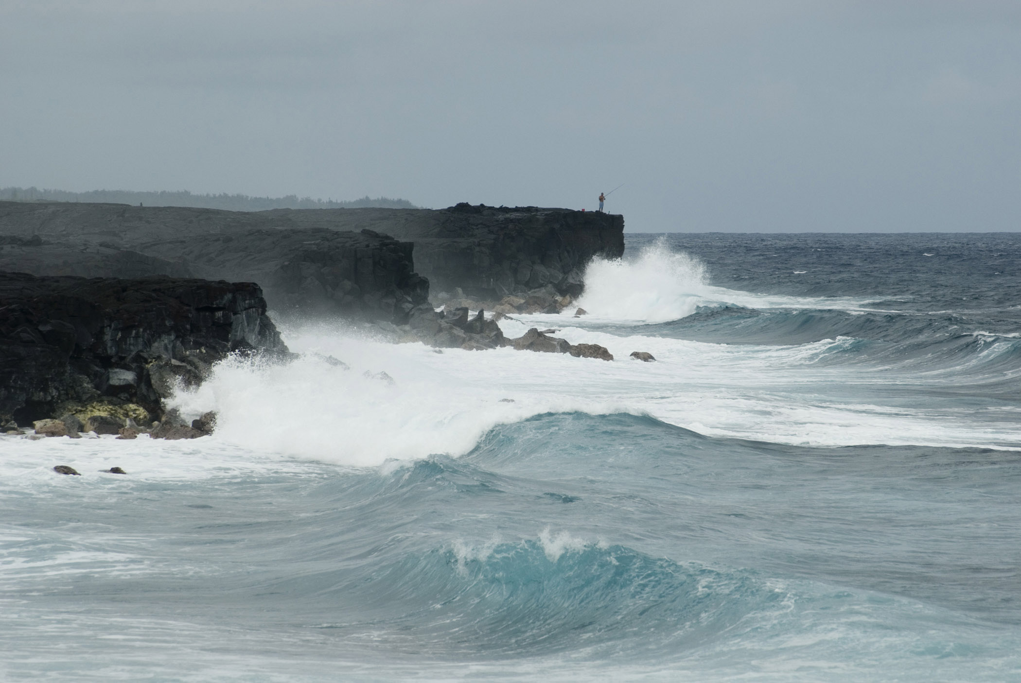 Rugged oceanscape with powerful waves breaking upon coastal cliffs on Big Island , Hawaii