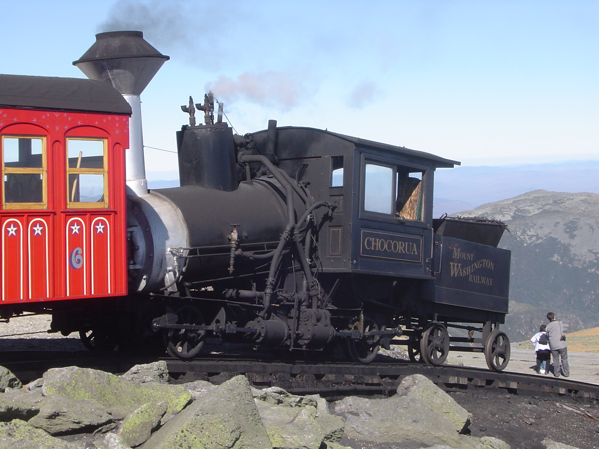 Close up Vintage Locomotive Vehicle at Cog Railway. Isolated on Light Blue Sky Background.