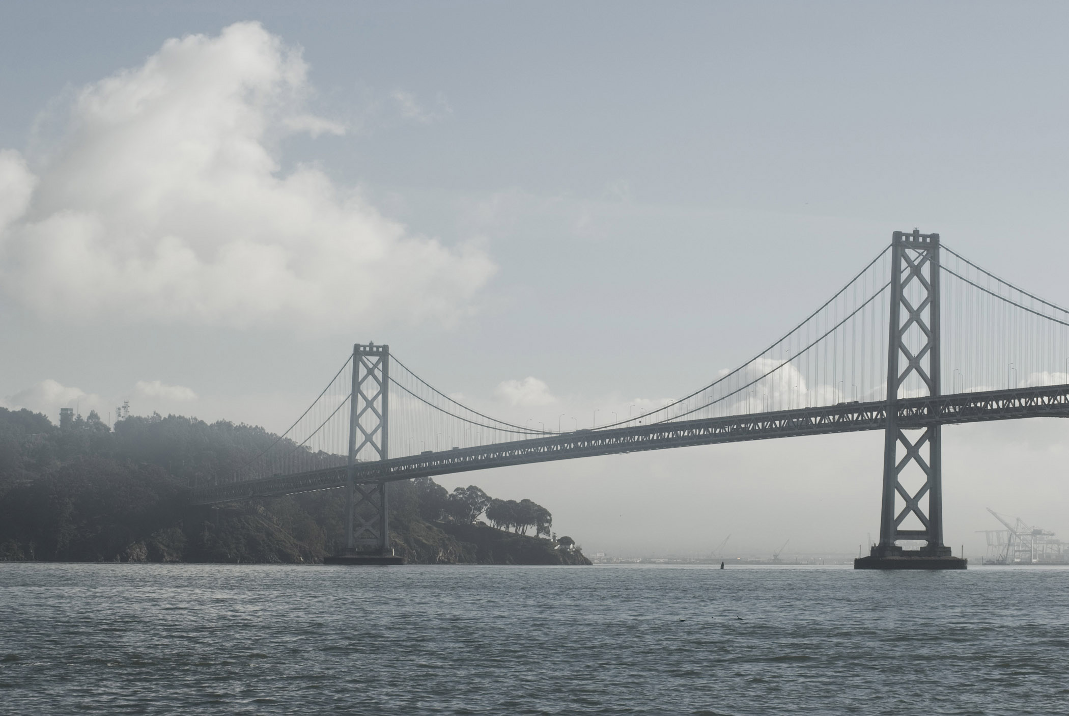 Famous Landmark Bay Bridge in San Francisco with cloudy sky