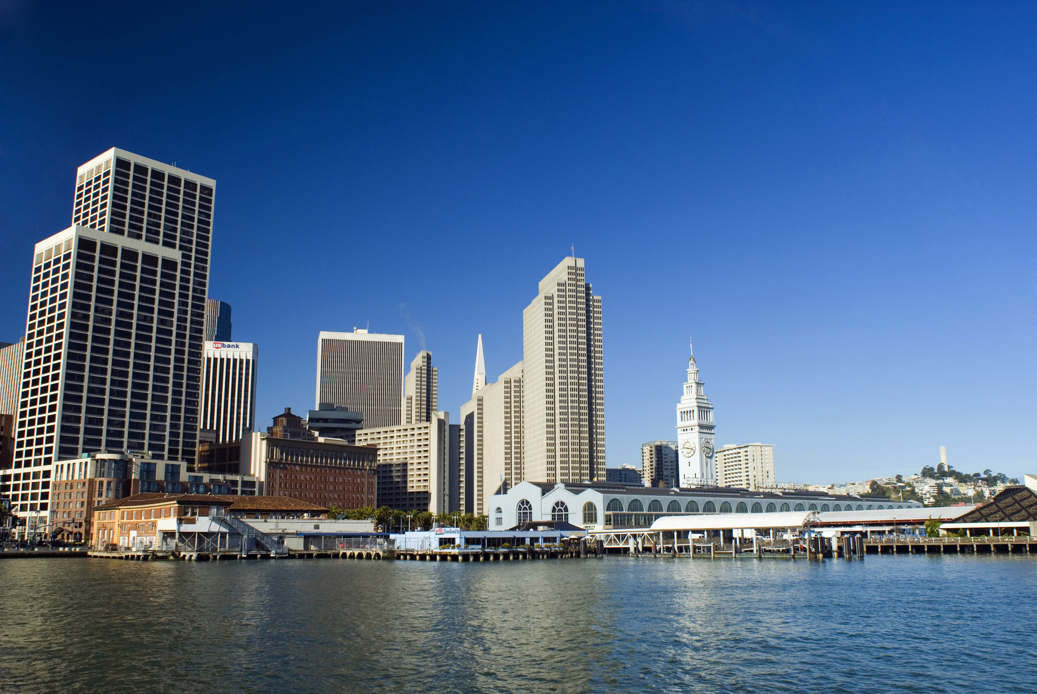 View of the city skyline and waterfront pier near the Embarcadero in San Francisco viewed across the water