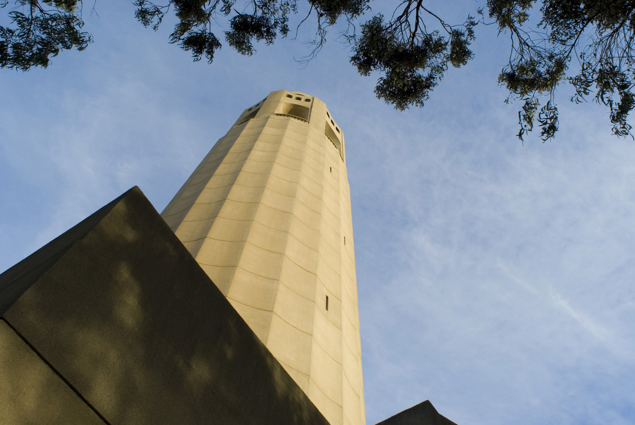 Famous Old Vintage Coit Tower in Worms Eye View Isolated on Light Blue Sky Background.