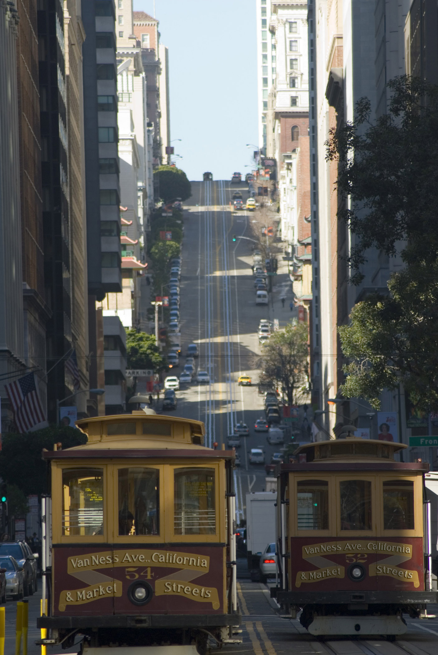 Trams passing each other on a steep urban street in Nob Hill,an affluent neighbourhood of San Francisco, California, USA