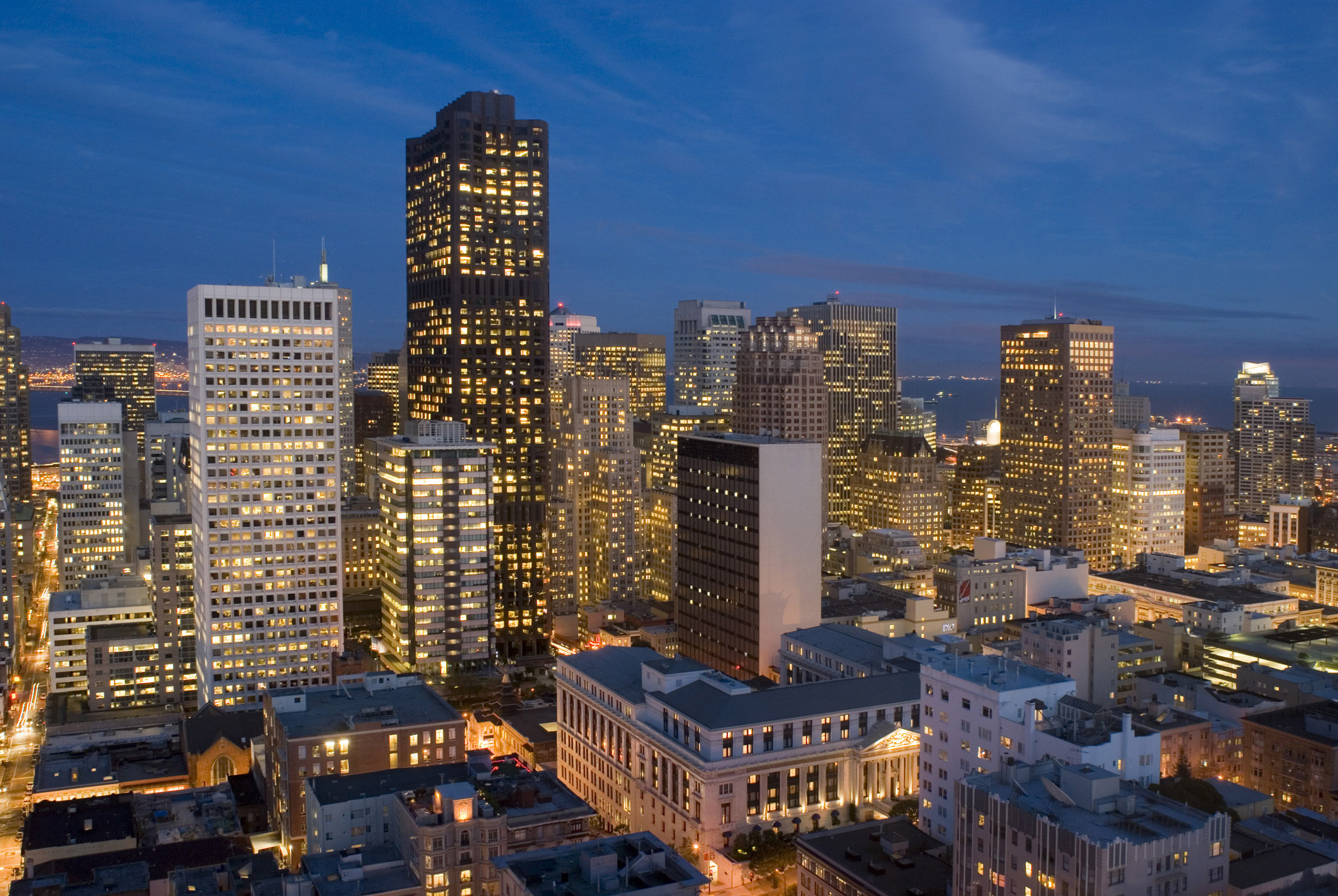 Beautiful Lights From Architectural Buildings In San Francisco At Night In  Extensive View.