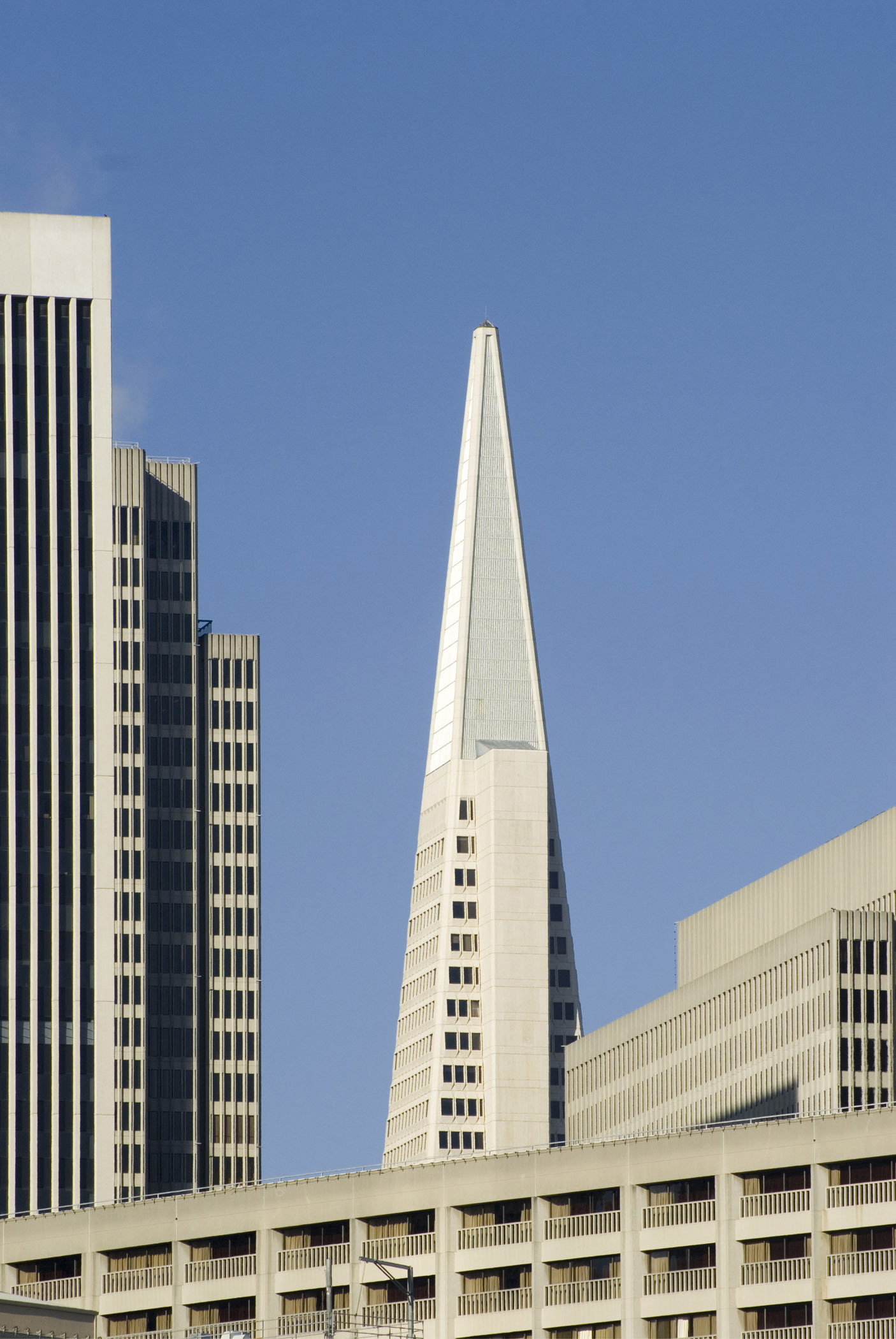 Architectural Tall Vintage Buildings at San Francisco on Blue Gray Sky Background.