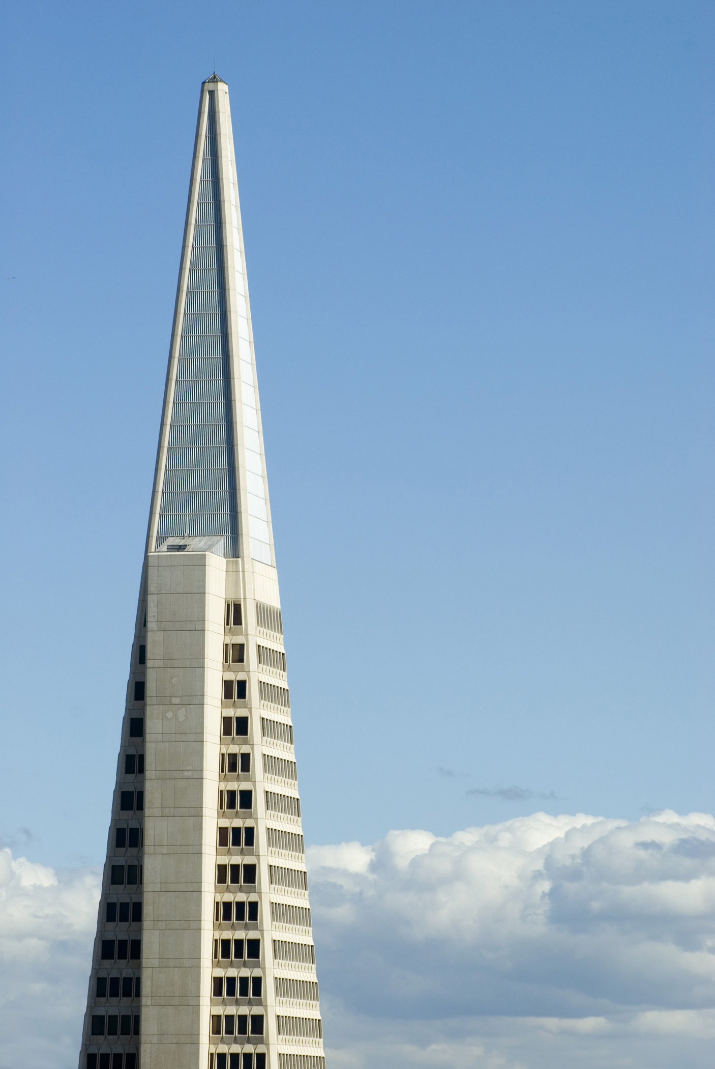 Exterior view of the facade of the Transamerica Pyramid building, San Francisco , California, USA against a sunny blue sky