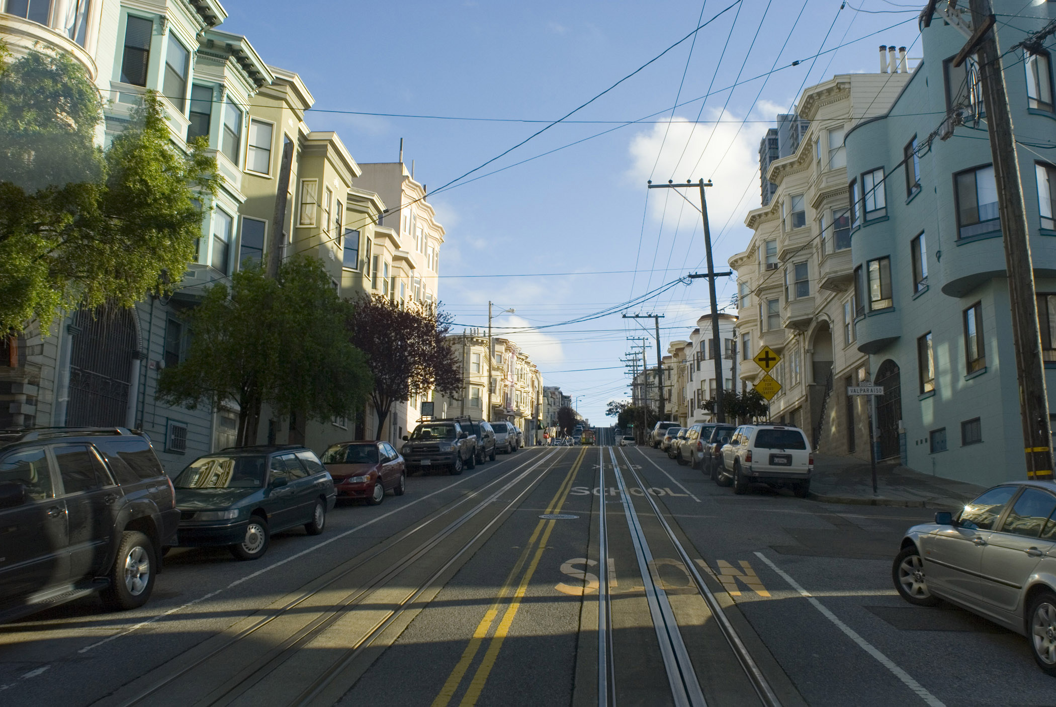 Cable car ride through the streets of San Francisco looking back along the tracks down the street in a residential district