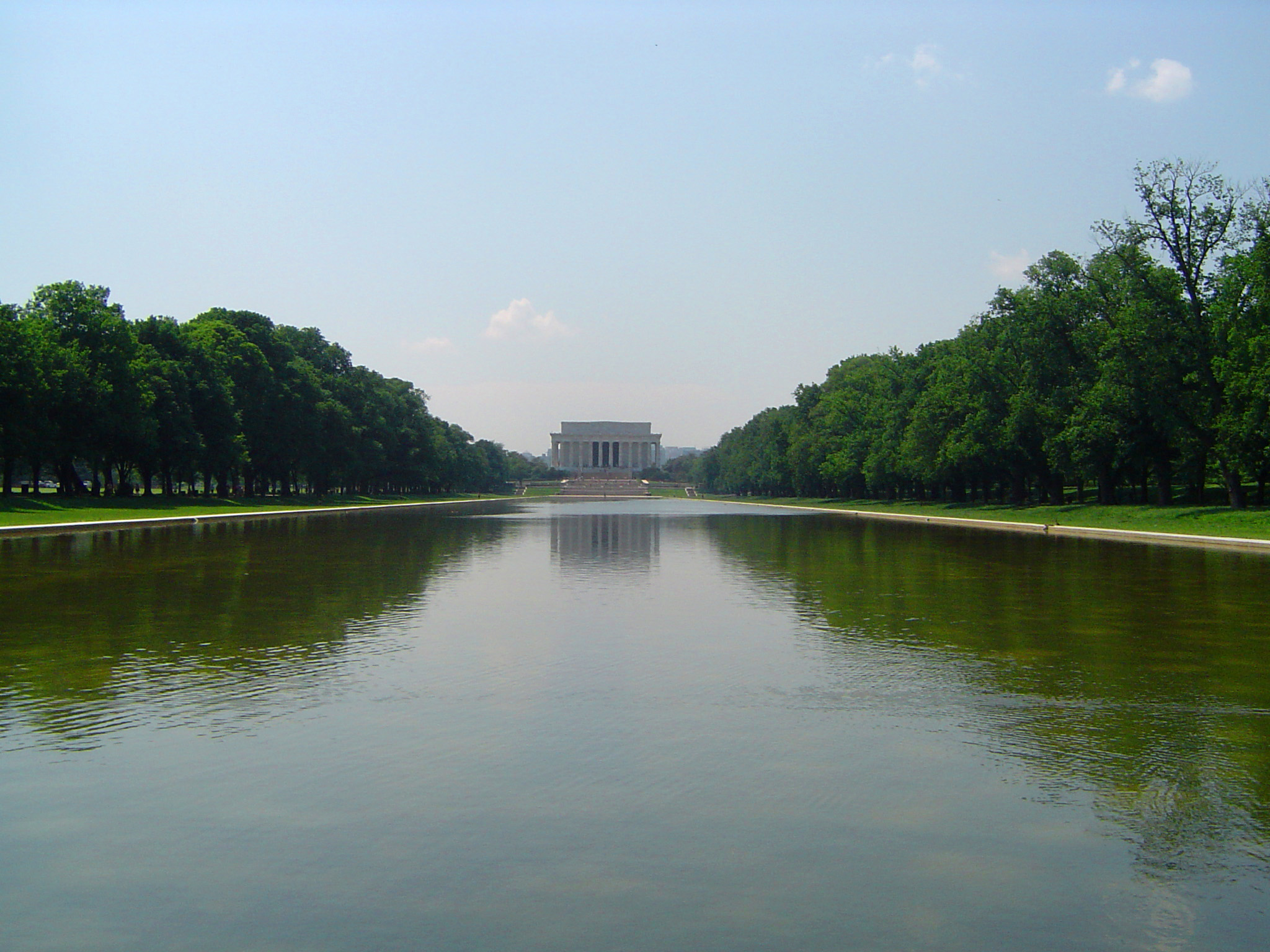 Reflecting Pool in Front Lincoln Memorial Building Surrounded by Tall Green Trees, Located in Washington