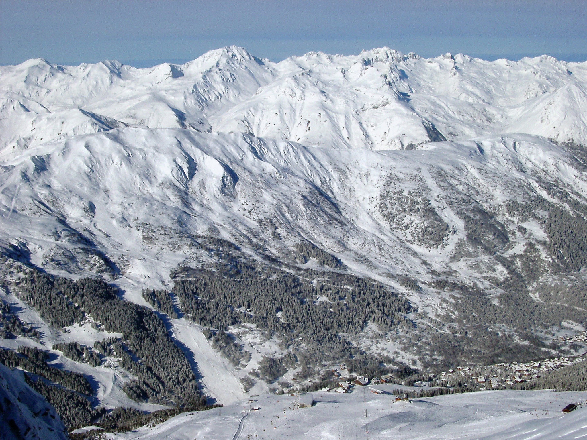 Snow covered mountain ranges with rugged peaks encased in fresh white snow in winter in France