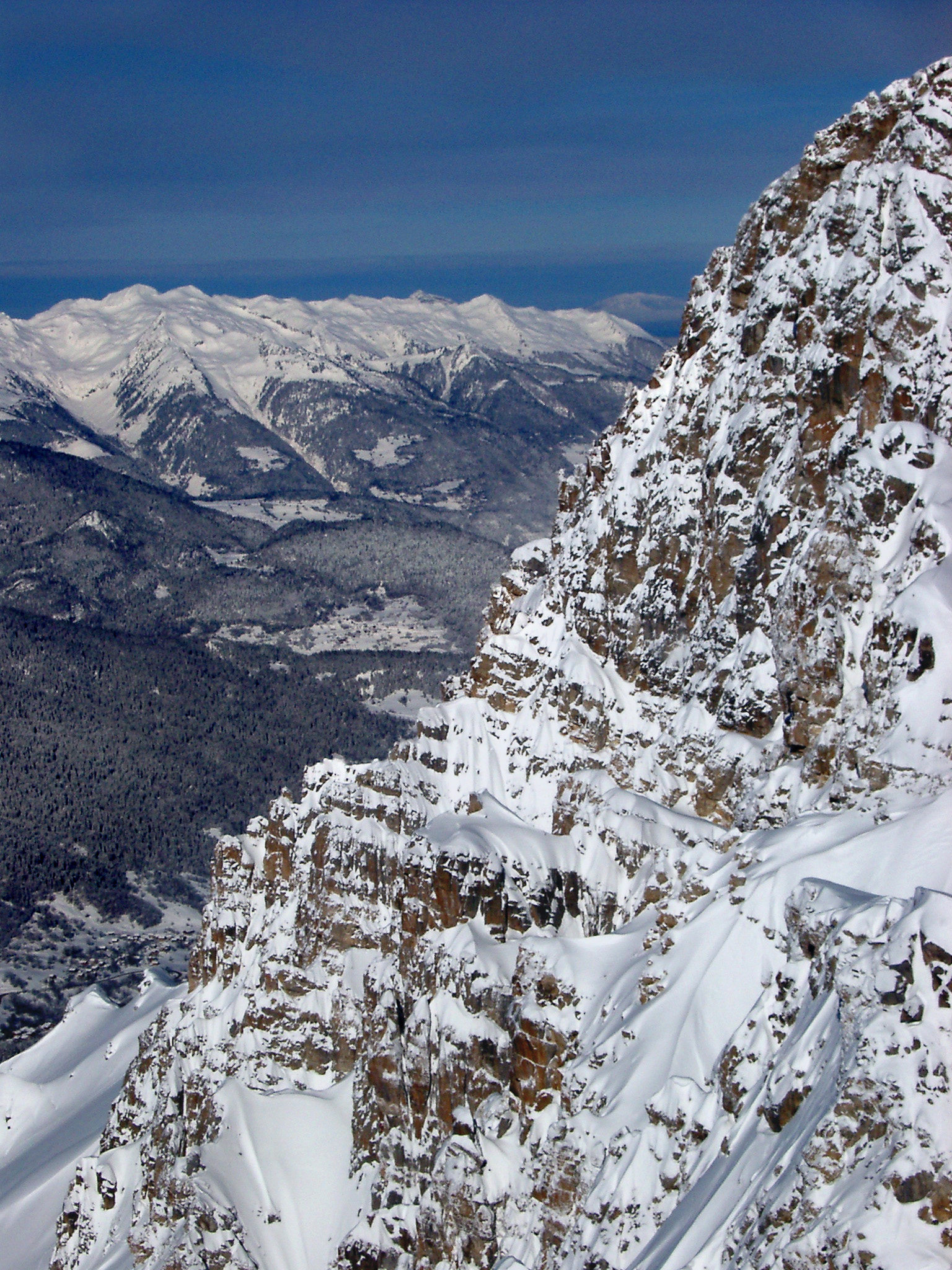 Beautiful View of Huge French Mountains Covered with Snow During Winter Holiday Season.