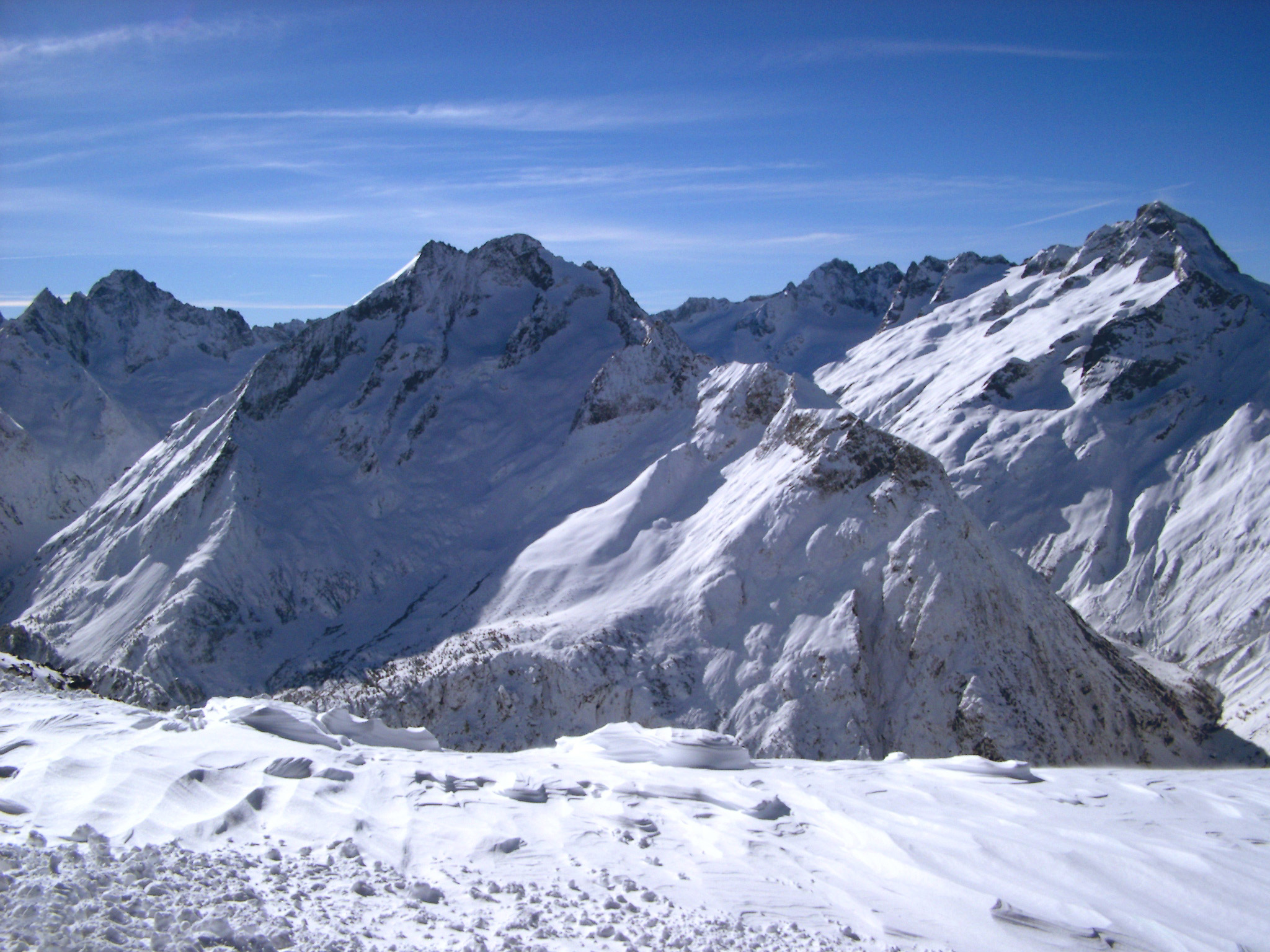 Attractive View of Snow Filled Mountains on Winter Holiday Season with Light Blue Sky Background.
