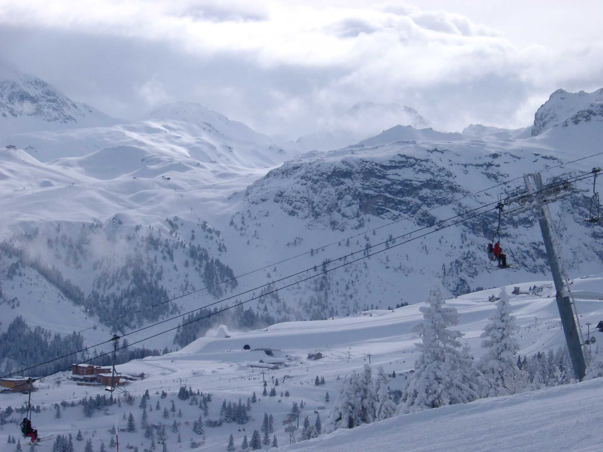 Extensive View of Beautiful Piste for Mountain Sports, like Skiing and Snowboarding, Captured with Cable Cars Passing on Winter Holiday Season.