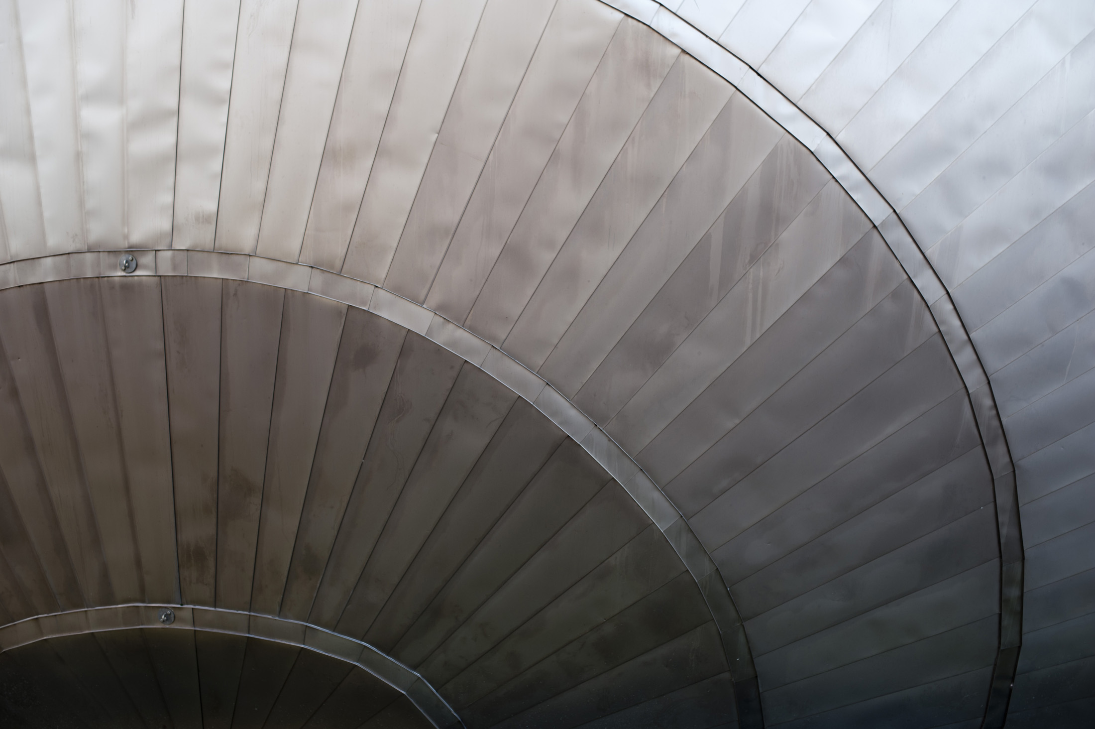 Glasgow IMAX cinema architectural design details showing the unusual titanium cladding covering the curved frame
