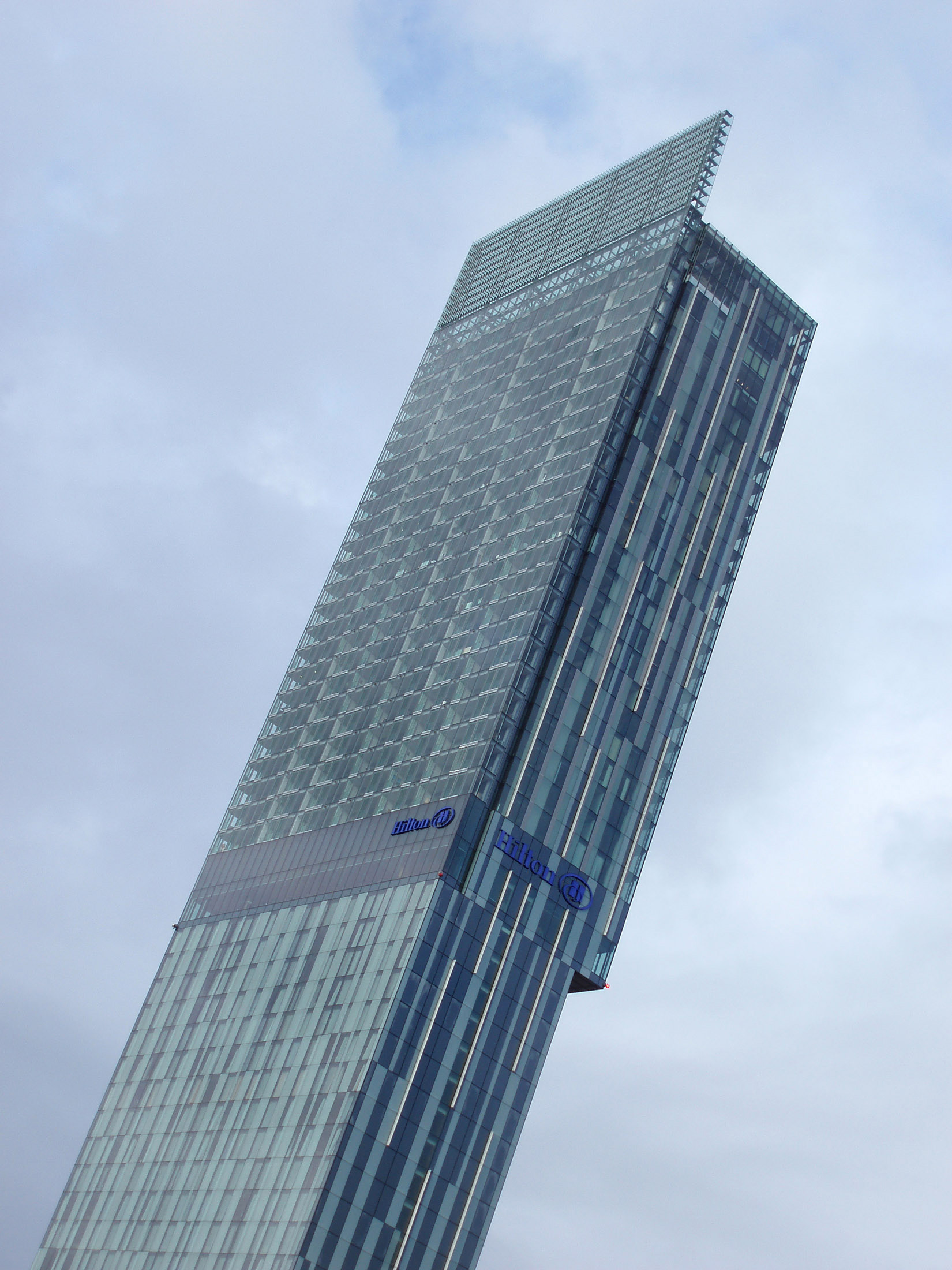 Famous Architectural Tall Beetham Tower Building in Manchester on a Cloudy Sky Background.