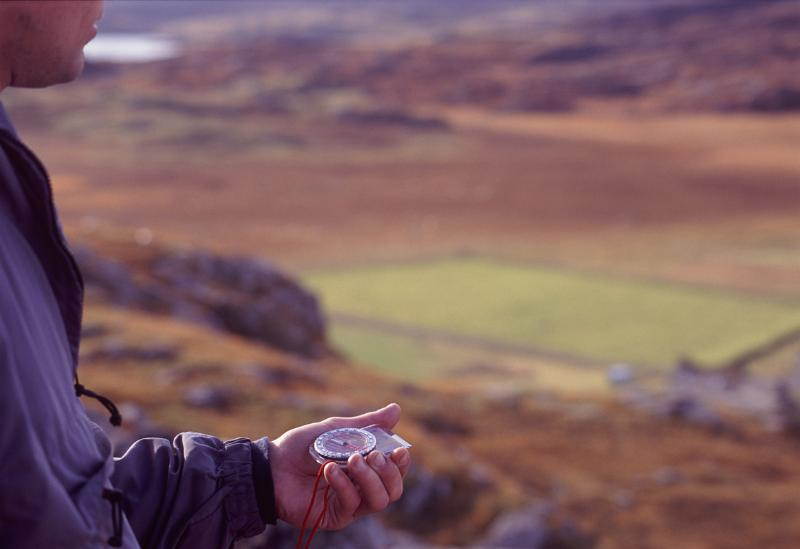 Free Stock photo of Man holding a compass in his hand ...
