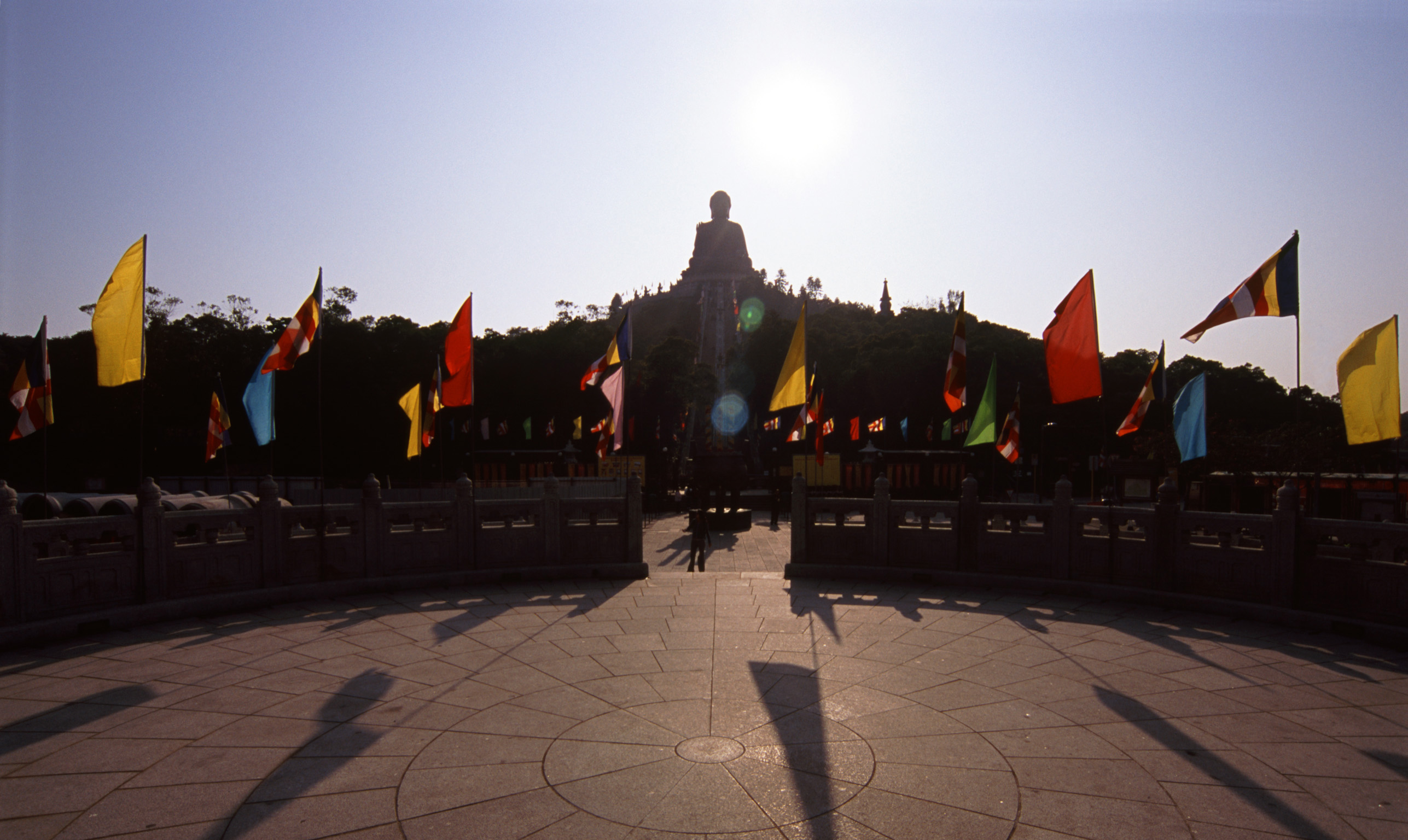 Large Buddha Backlit by Sun at Hong Kong Temple, China