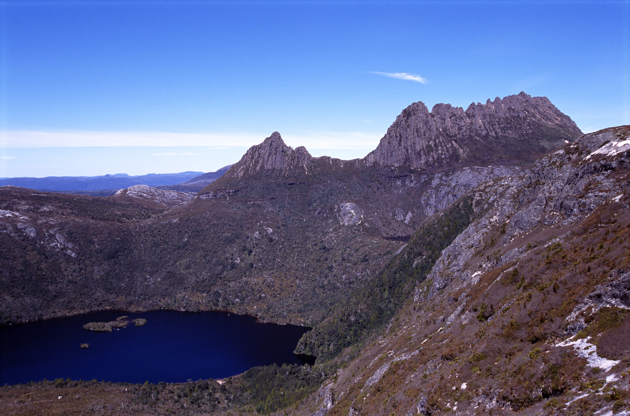 Scenic view of Cradle Mountain Tasmania and the surrounding rugged mountain peaks in the highlands in the heart of Cradle Mountain-Lake St Clair National Park