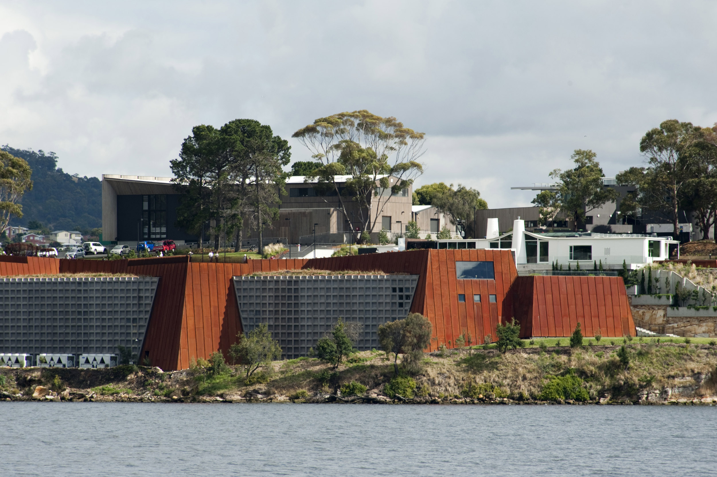 The Mona art gallery building exterior and surrounding river in Hobart, Australia.